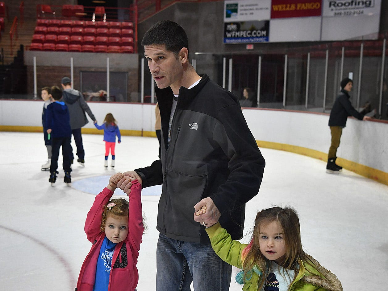 Jay Waklid had his hands full as he helps his daughter, Piper Waklid, right, and her friend, Hadley Atwood, ice skating Friday at the Kay Yeager Coliseum.