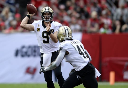 FILE - In this Dec. 9, 2018, file photo, New Orleans Saints quarterback Drew Brees (9) throws a pass to running back Alvin Kamara (41) during the first half of the team's NFL football game against the Tampa Bay Buccaneers in Tampa, Fla. Brees, who turns 40 on Jan. 15, is a leading MVP candidate after breaking his own NFL record for completion percentage, connecting on 74.4 percent of his passes a year after connecting on 72 percent.