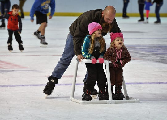In this file photo, Curtis Hoskins pushes his daughters, Sadie, left, and Piper, around the ice at Kay Yeager Coliseum during the last Open Skate event of the season.
