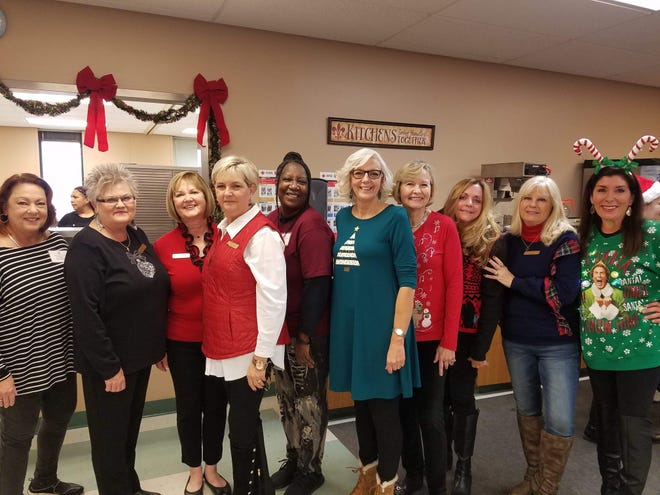 Senior-Junior Forum members served lunch at the Kitchen's Christmas luncheon. SJF supports the Kitchen by volunteering at their events, Meals on Wheels routes and donating a portion of the Red River Wine and Beer Festival. Members from left to right: Robin Bowen, Roma Martin, Annette Barfield, Delores Culley, Jean Snow, Lydia McWhorter, Loisanne Neal, LaNell Kruger, Ladell Schmalzried and Pam Hughes.