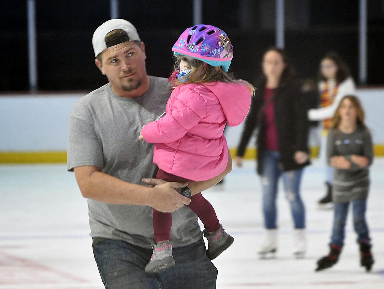 Jaime Allard takes his daughter, Raigan Allard, 2, for a skate Friday afternoon at Kay Yeager Coliseum. First Bank sponsored an Open Skate event, the last one of the season.