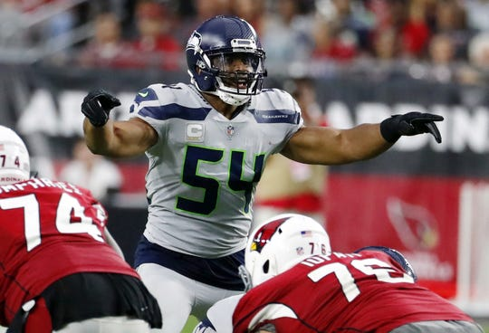 FILE - In this Sept. 30, 2018, file photo, Seattle Seahawks linebacker Bobby Wagner (54) gestures at the line of scrimmage during an NFL football game against the Arizona Cardinals in Glendale, Ariz. Seattle's Bobby Wagner and Sean Lee of Dallas were the All-Pro leaders of their defenses at linebacker the previous time the Seahawks and Cowboys made the playoffs.Little has changed for Wagner's group in two years. Not much is the same for the middle of the Dallas defense going into the first postseason meeting between the teams since the 2006 season.