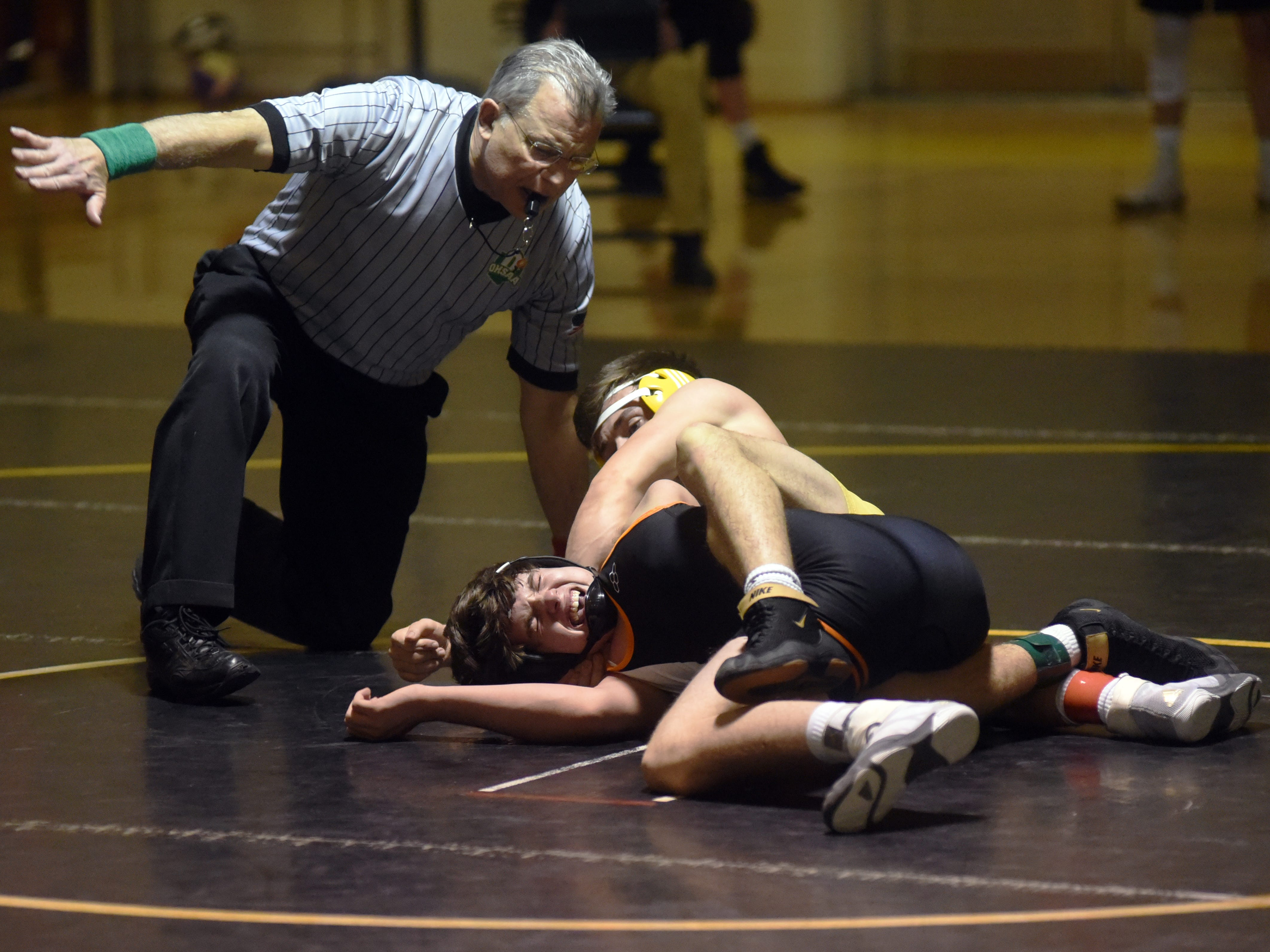 Tri-Valley's Connor McIntire tries to pin New Lexington's Trey Helwig at 145 pounds.