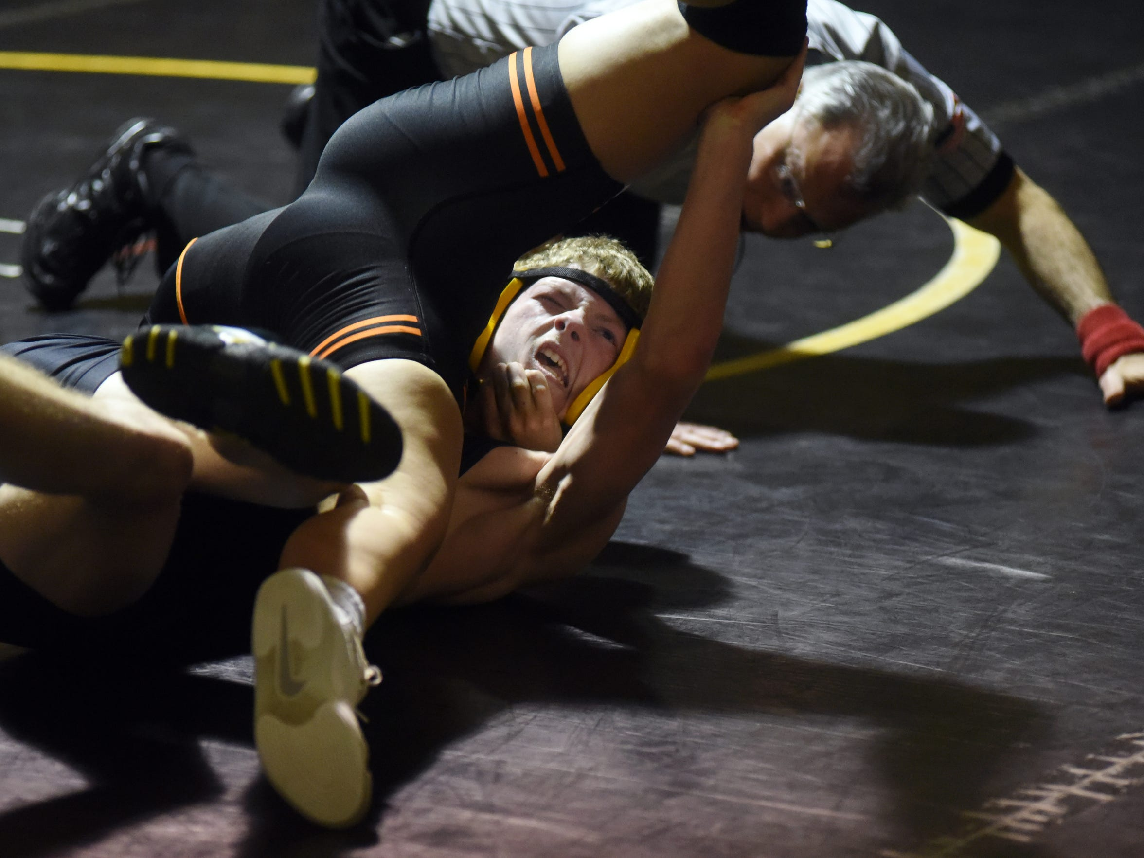 New Lexington's Leilah Castro puts Tri-Valley's Tyler Crawford on his back during their match at 126 pounds.