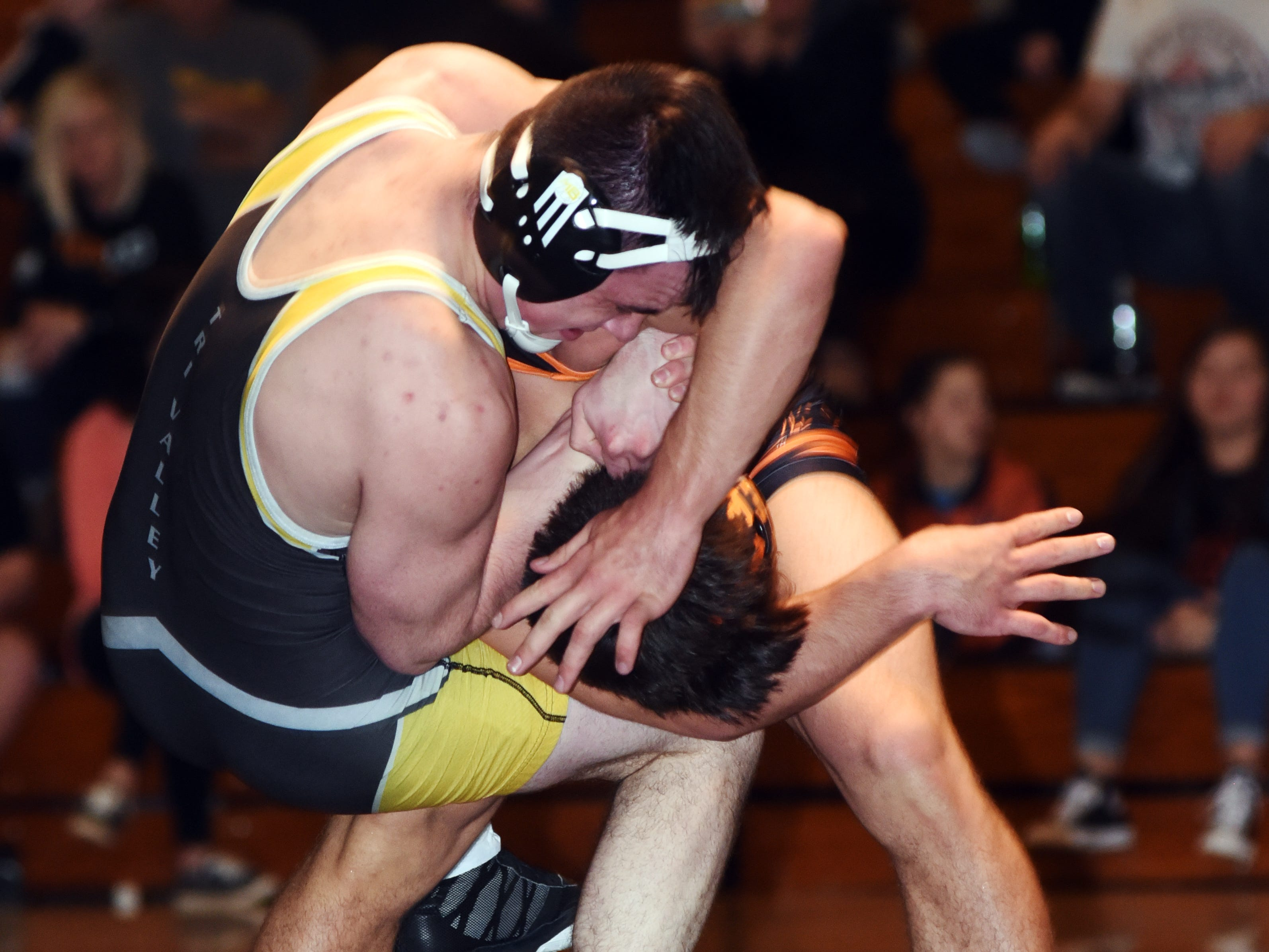 Tri-Valley's Porter Blackmond tries to fight away from New Lexington's Layne Talbot at 170 pounds.