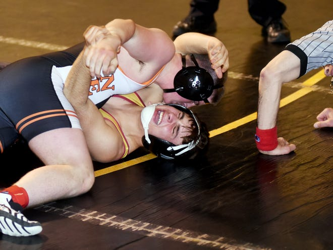New Lexington's Hayden Shoults pins Tri-Valley's David Coleman in the third period of their 160-pound match on Thursday in Dresden. The Panthers won, 42-31, to stay unbeaten in the Muskingum Valley League.