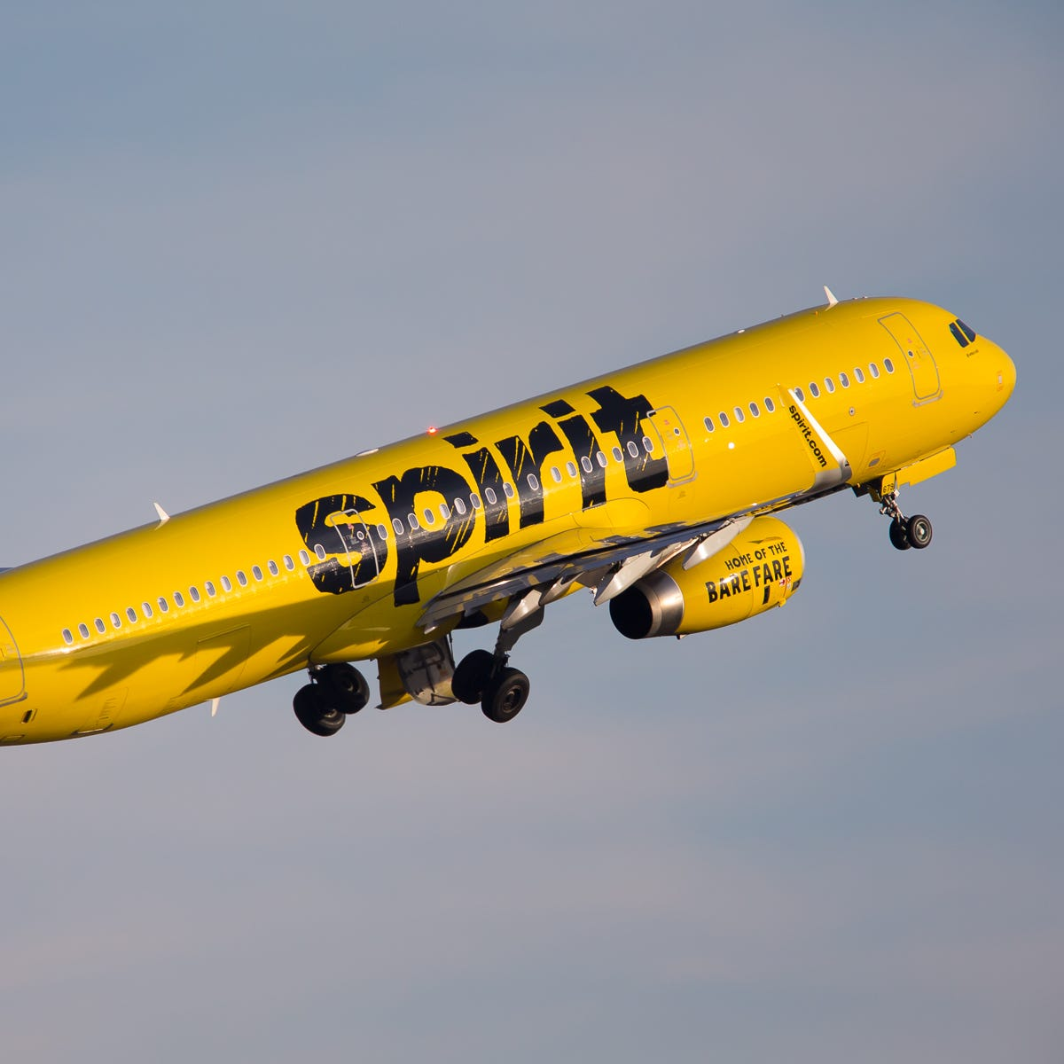 A Spirit Airlines Airbus A321 departs Seattle-Tacoma International Airport in November 2018.