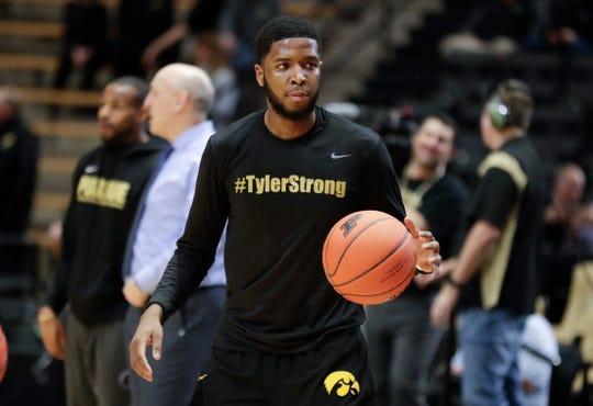 Iowa guard Isaiah Moss wears a shirt honoring Tyler Trent before a game against Iowa,