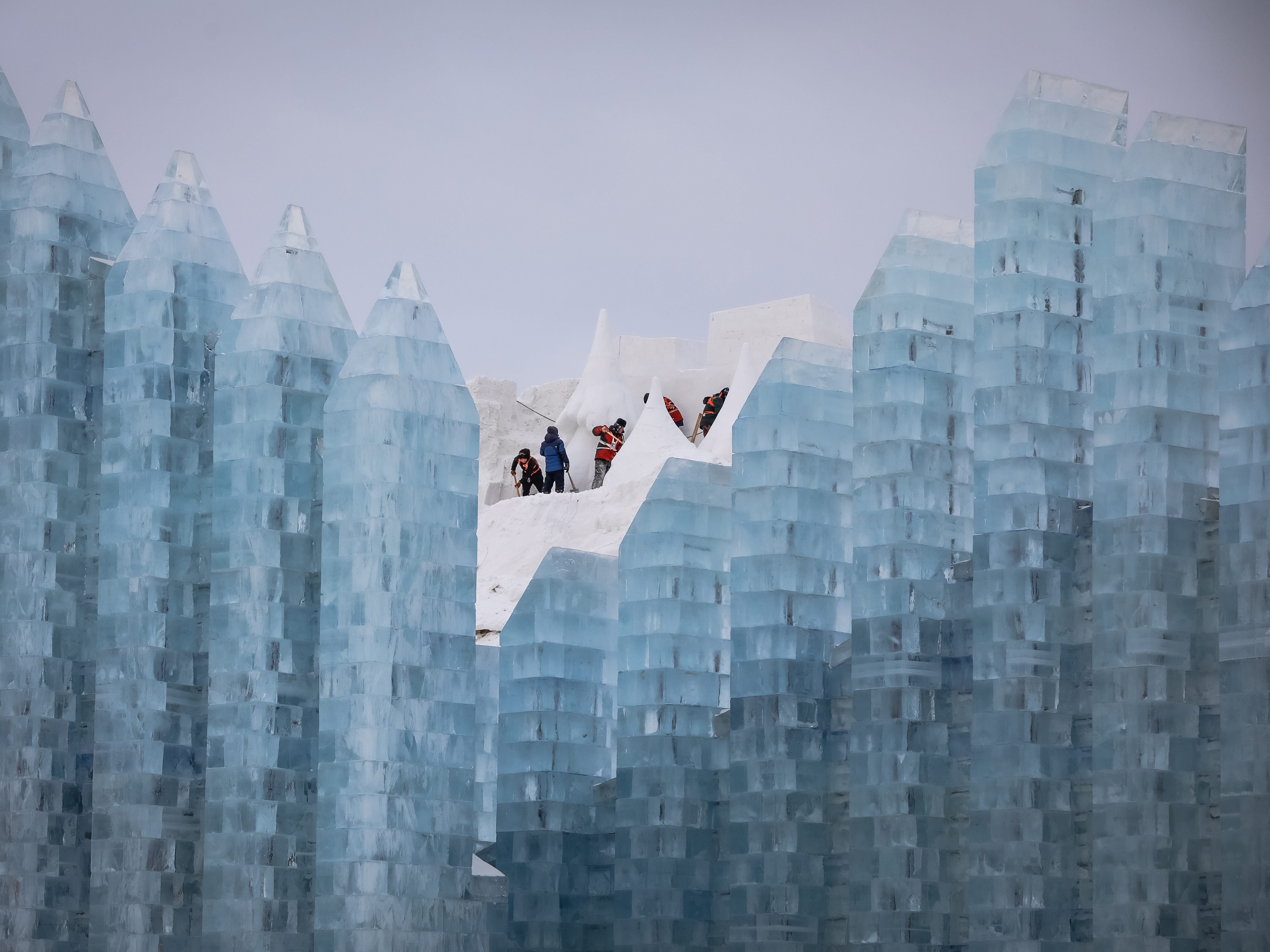 Workers prepare the snow sculptures.