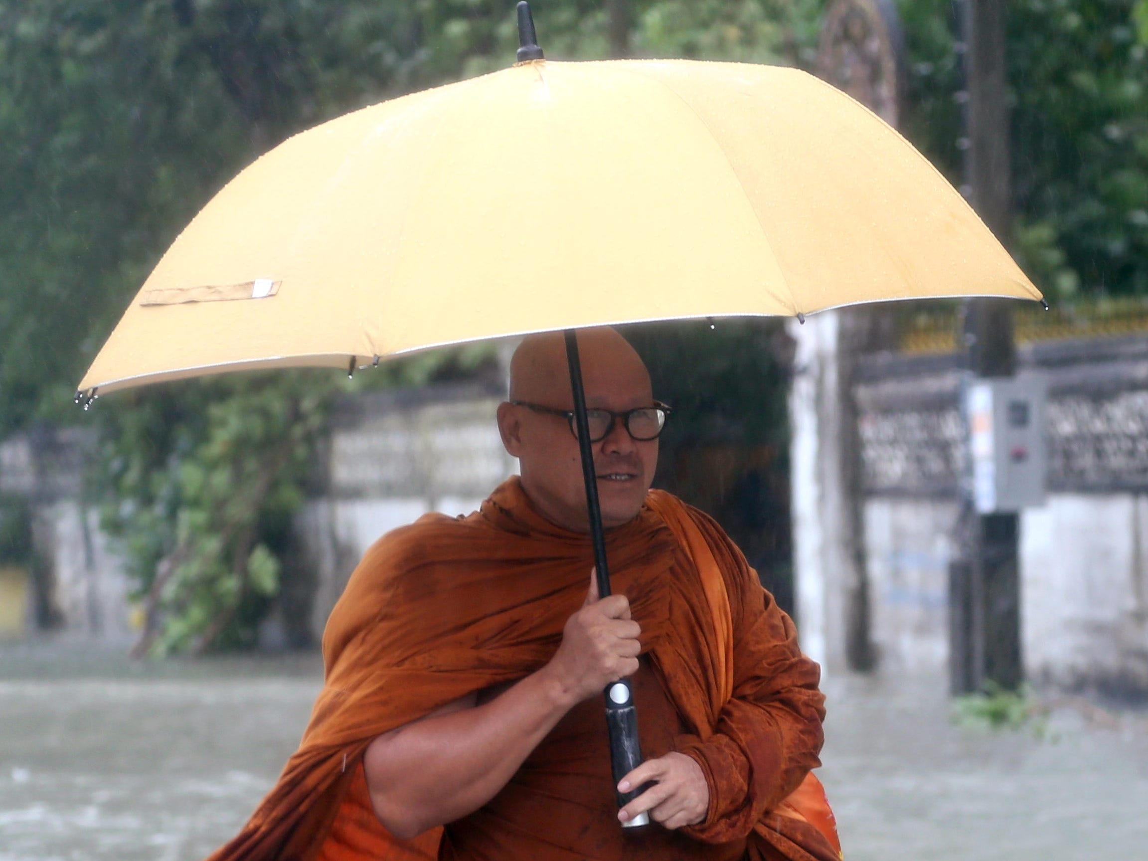 epa07261519 A Thai Buddhist monk wades through a flooded street caused by tropical storm Pabuk at Pak Phanang district, Nakhon Si Thammarat province, southern Thailand, 04 January 2019. Thousands of people evacuated from their homes after 11 southern coast provinces have been put on a weather warning as tropical storm Pabuk brought heavy downpours, strong winds and high waves. Pabuk is the first tropical storm to hit the country outside of the monsoon season in nearly 30 years, media reported.  EPA-EFE/STRINGER THAILAND OUT ORG XMIT: RUN07