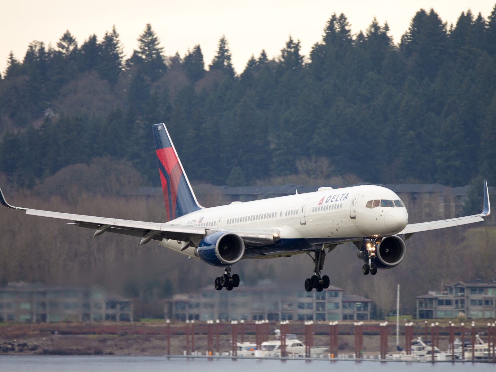 A Delta Air Lines Boeing 757-200 lands at Portland International Airport in December 2018.