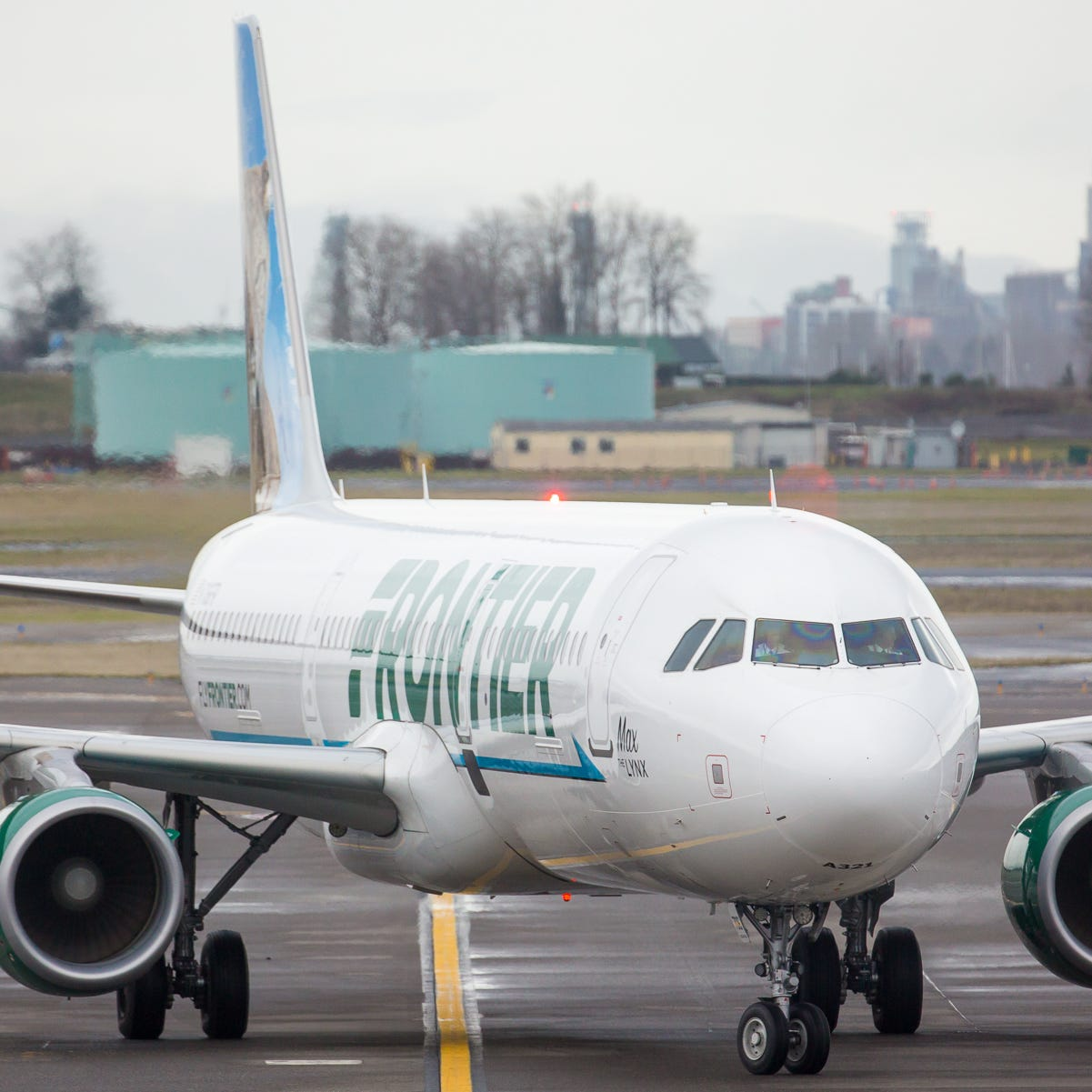 A Frontier Airlines Airbus A321 taxis to Gate D4 at Portland International Airport in December 2018.