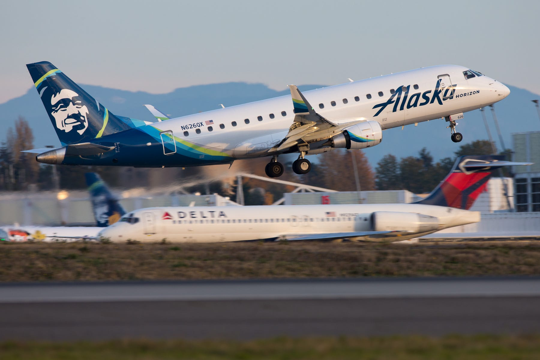 An Alaska Airlines/Horizon Air Embraer E170 takes off from Seattle-Tacoma International Airport in November 2018.