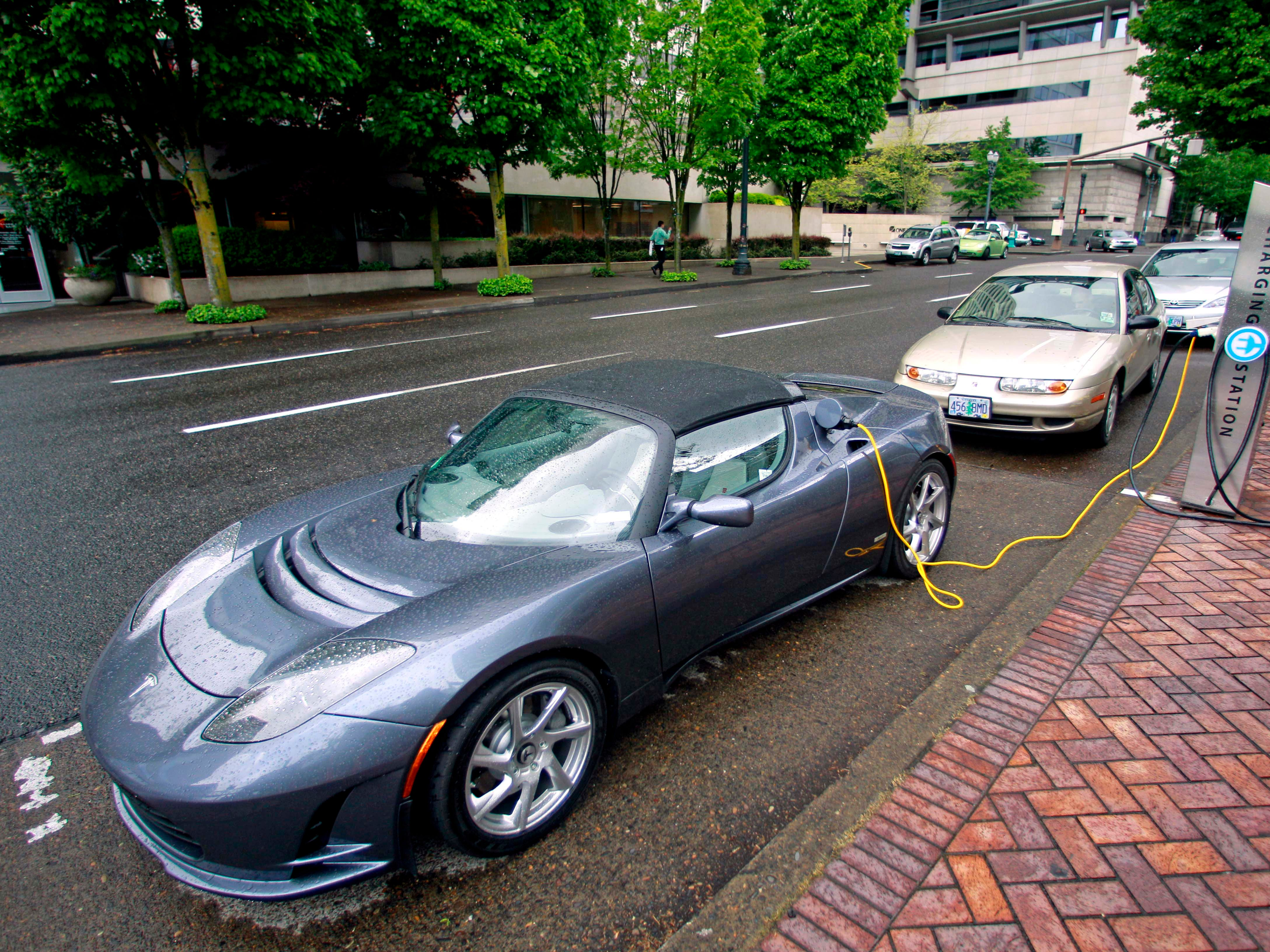 A Tesla Roadster Sport at a charging station in Portland, Ore. May 27, 2011.