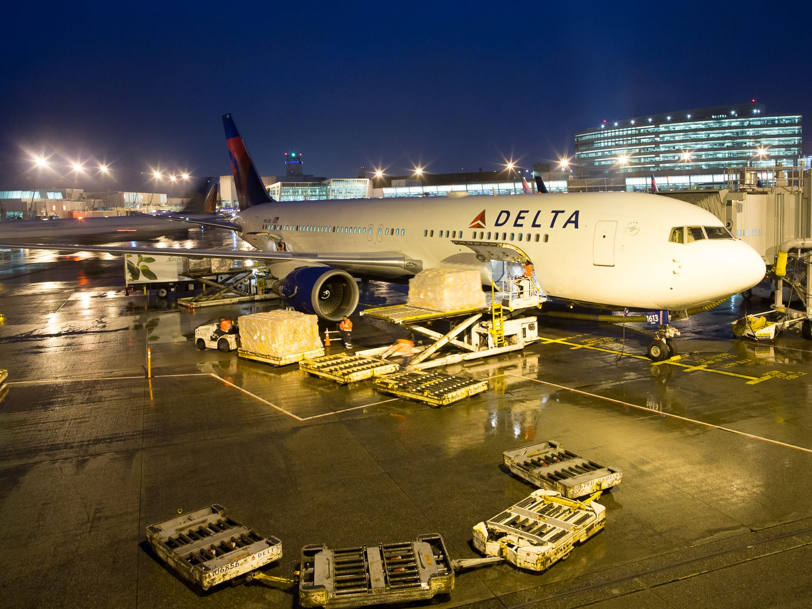Cargo is offloaded from a Delta Air Lines Boeing 767-300 at Seattle-Tacoma International Airport in December 2018.