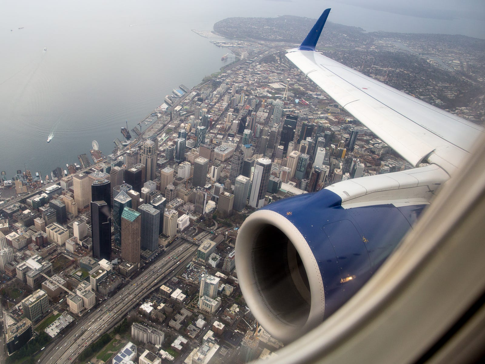 Downtown Seattle makes a spectacular appearance out the window of a Delta Air Lines Embraer E170 on its final approach to Seattle-Tacoma International Airport in December 2018.