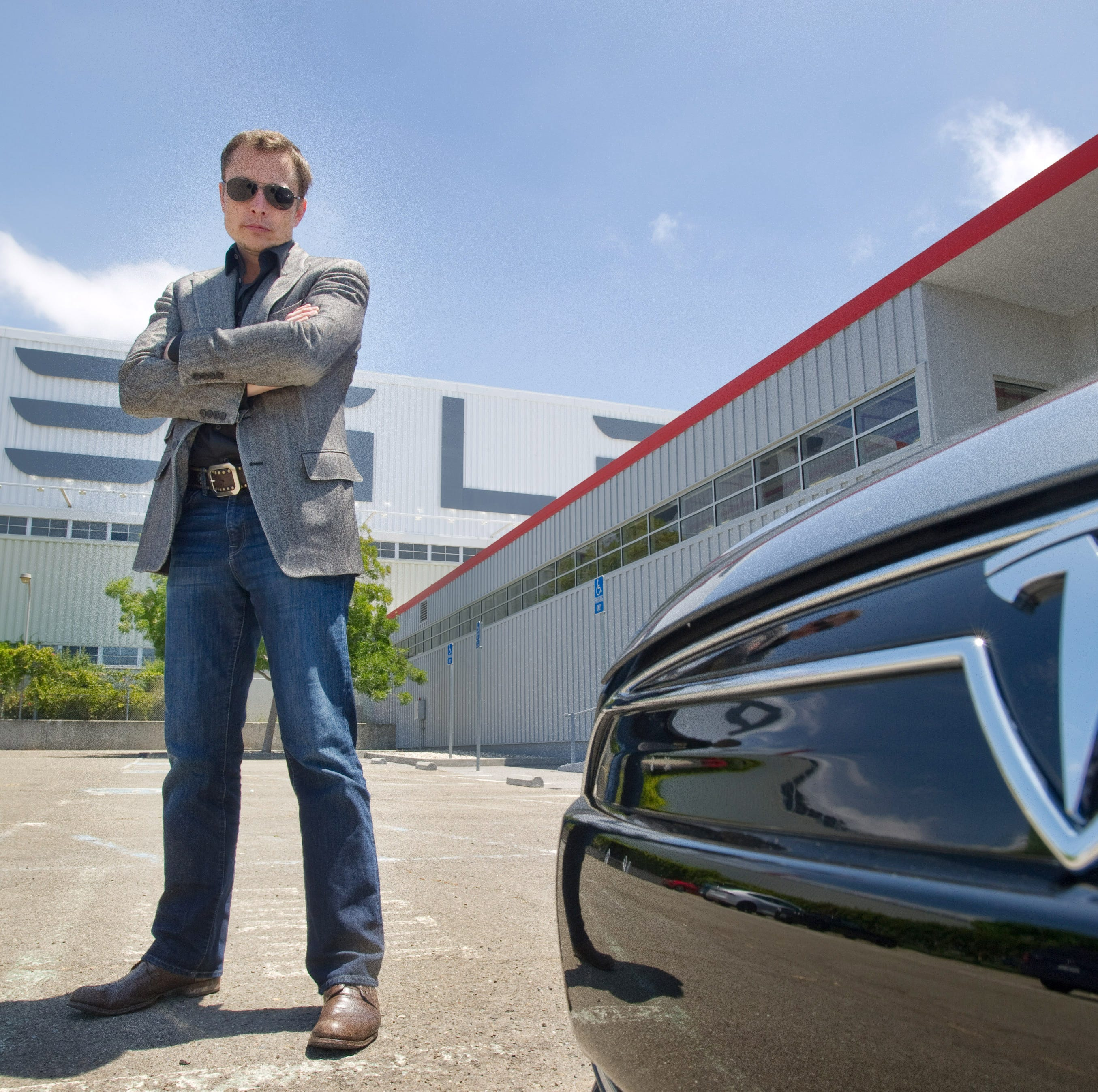 Elon Musk CEO, Cofounder, Chief Product Architect for Tesla with a new Model S  car outside the Tesla customer deliver area at the Tesla Fremont factory, June 21, 2012.