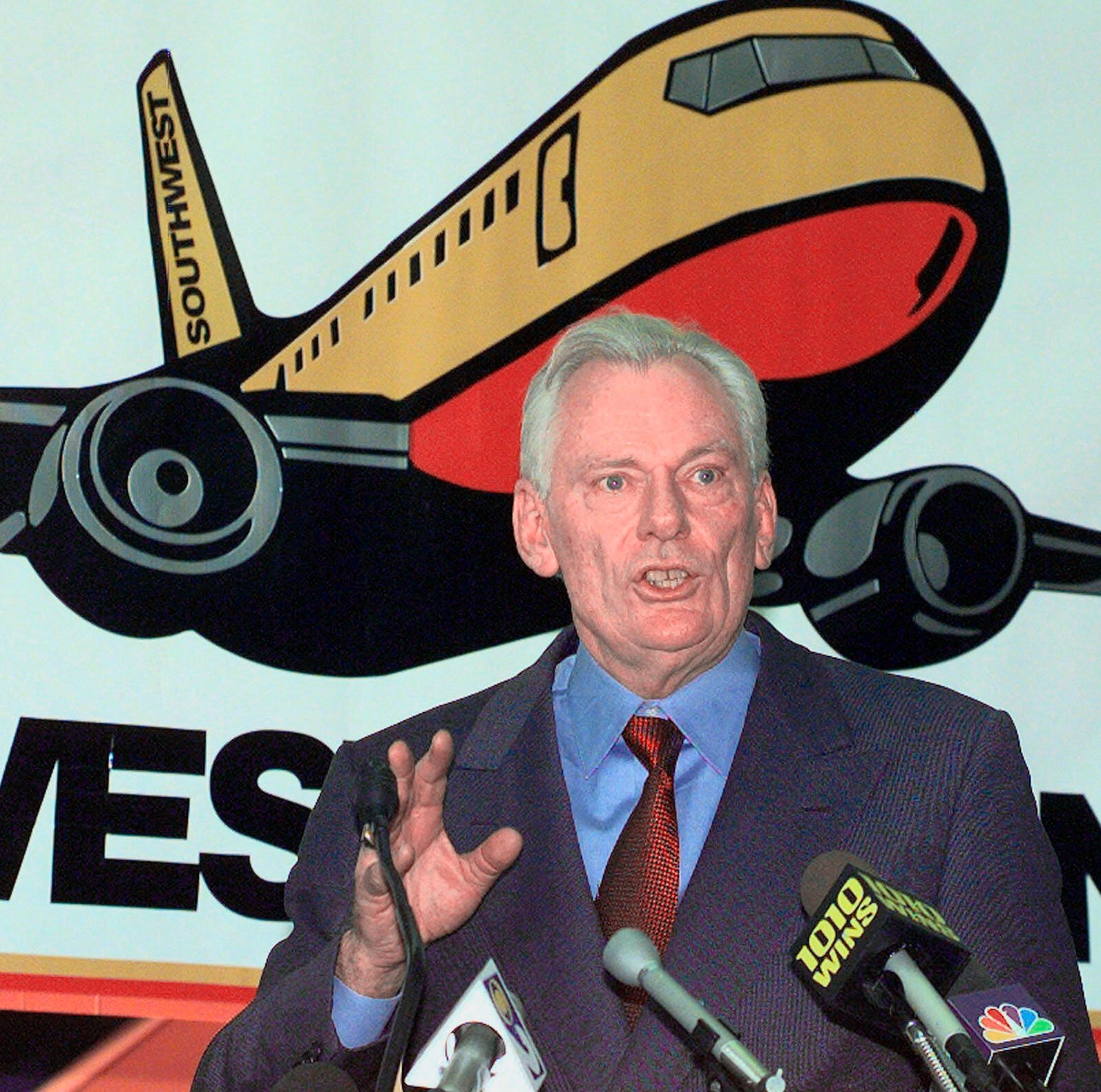 FILE - In this Dec. 9, 1998, file photo, Southwest Airlines President and CEO Herb Kelleher speaks at a news conference at MacArthur Airport in Islip, N.Y. Not many CEOs dress up as Elvis Presley, settle a business dispute with an arm-wrestling contest, or go on TV wearing a paper bag over their head. Southwest confirmed Kelleher died on Thursday, Jan. 3, 2019. He was 87. (AP Photo/Ed Betz, File) ORG XMIT: NYHK402