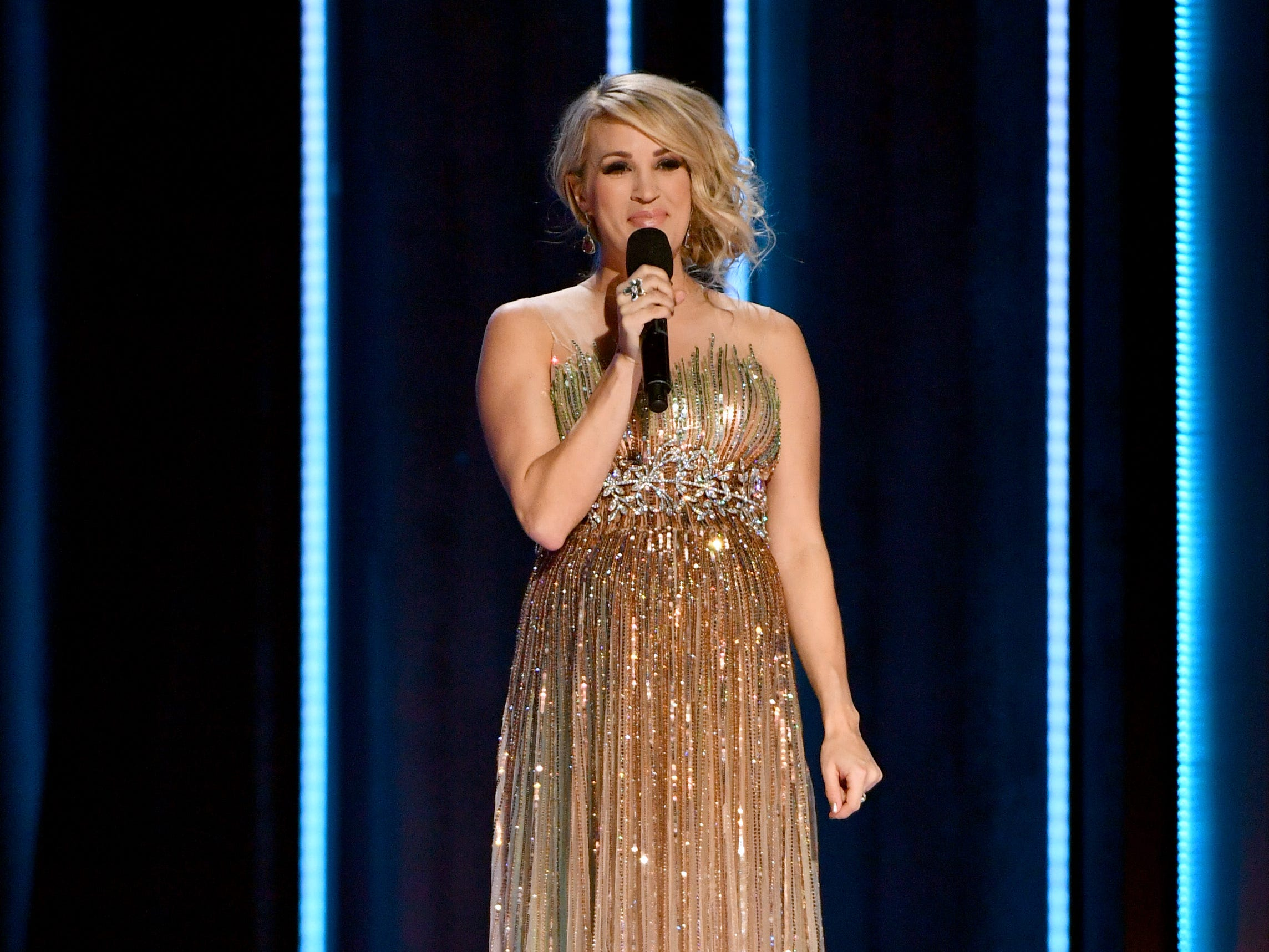 NASHVILLE, TN - NOVEMBER 14:  (FOR EDITORIAL USE ONLY) Singer Carrie Underwood speaks onstage during the 52nd annual CMA Awards at the Bridgestone Arena on November 14, 2018 in Nashville, Tennessee.  (Photo by Michael Loccisano/Getty Images) ORG XMIT: 775237563 ORIG FILE ID: 1061547476