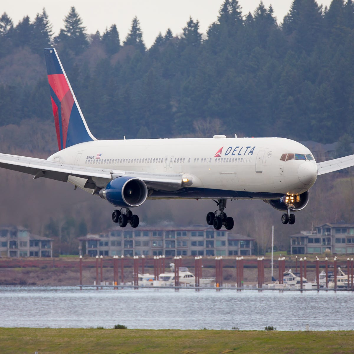 A Delta Air Lines Boeing 767-300 lands at Portland International Airport in December 2018.