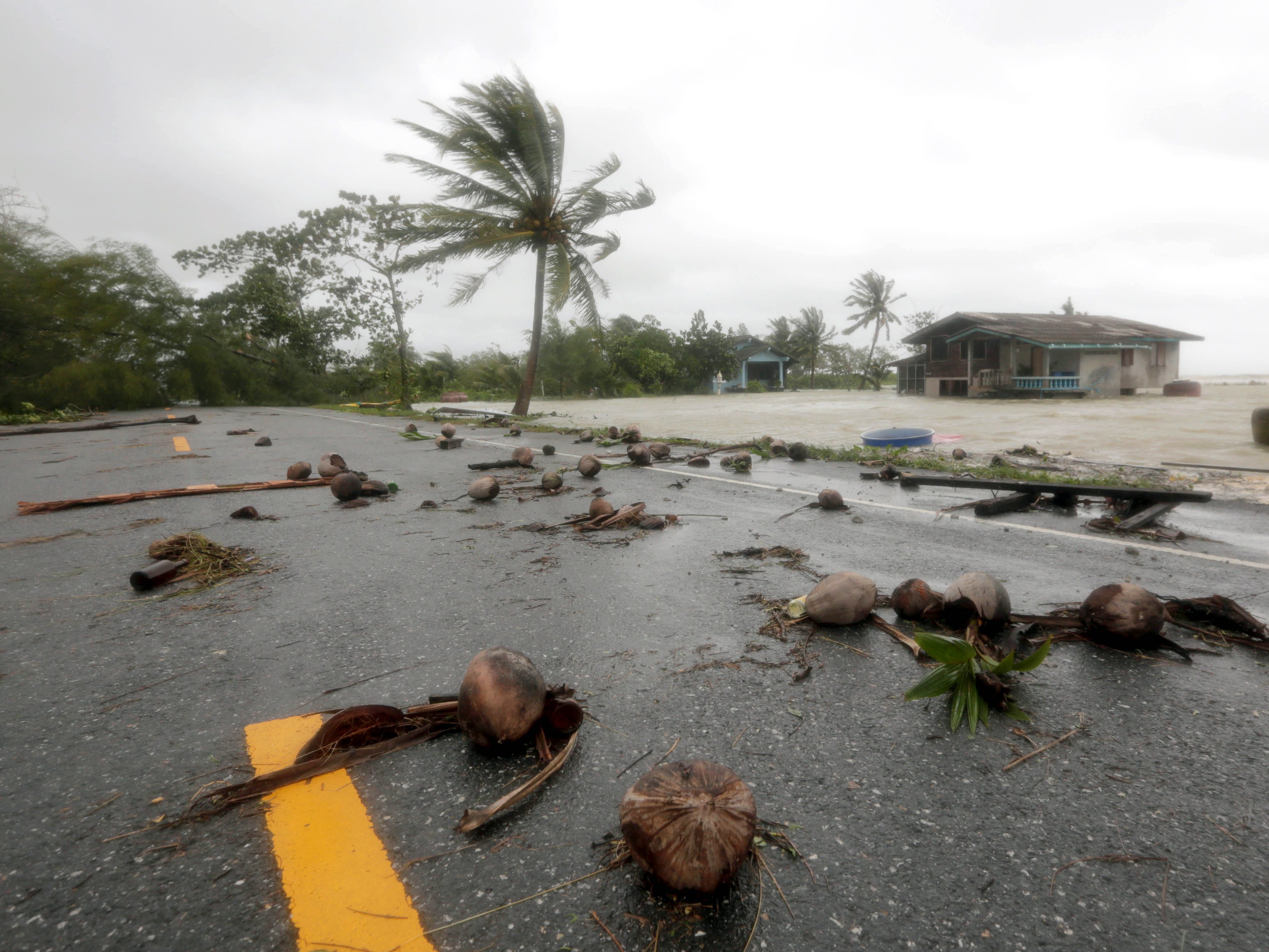 epa07261520 A view of debris on a road and a house (back) partially submerged in floodwaters caused by tropical storm Pabuk at a village in Pak Phanang district, Nakhon Si Thammarat province, southern Thailand, 04 January 2019. Thousands of people evacuated from their homes after 11 southern coast provinces have been put on a weather warning as tropical storm Pabuk brought heavy downpours, strong winds and high waves. Pabuk is the first tropical storm to hit the country outside of the monsoon season in nearly 30 years, media reported.  EPA-EFE/STRINGER THAILAND OUT ORG XMIT: RUN05