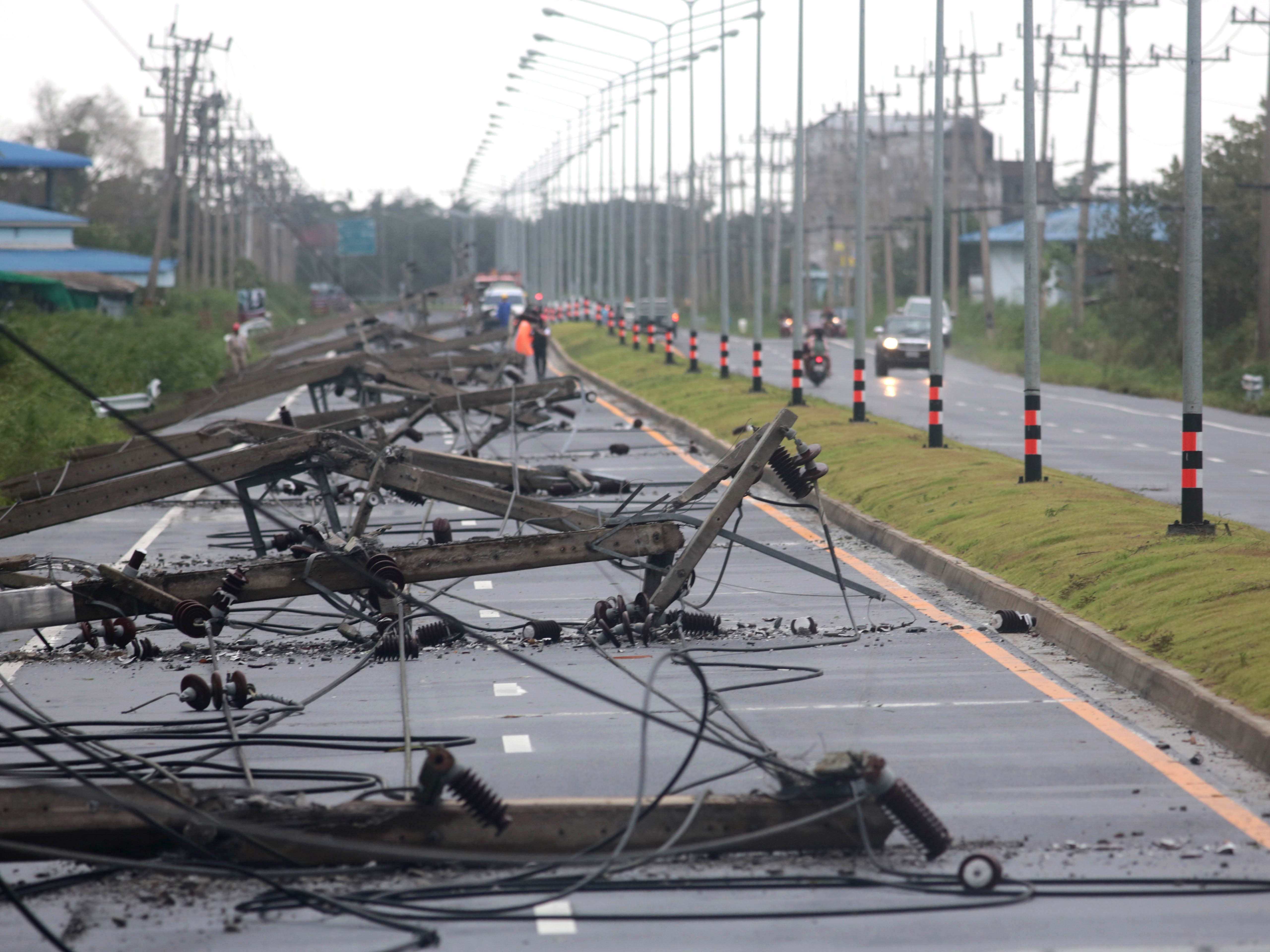 epa07261518 A view of collapsed electricity posts caused by tropical storm Pabuk along a main street at Pak Phanang district, Nakhon Si Thammarat province, southern Thailand, 04 January 2019. Thousands of people evacuated from their homes after 11 southern coast provinces have been put on a weather warning as tropical storm Pabuk brought heavy downpours, strong winds and high waves. Pabuk is the first tropical storm to hit the country outside of the monsoon season in nearly 30 years, media reported.  EPA-EFE/STRINGER THAILAND OUT ORG XMIT: RUN06