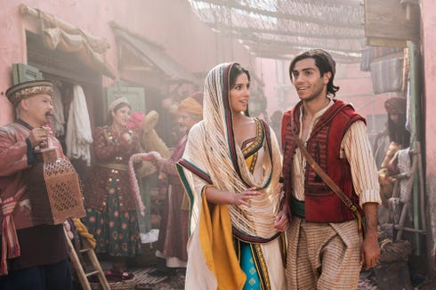 "Naomi Scott stars as Jasmine and Mena Massoud is the title character in Disney's live-action adaptation of ""Aladdin."""