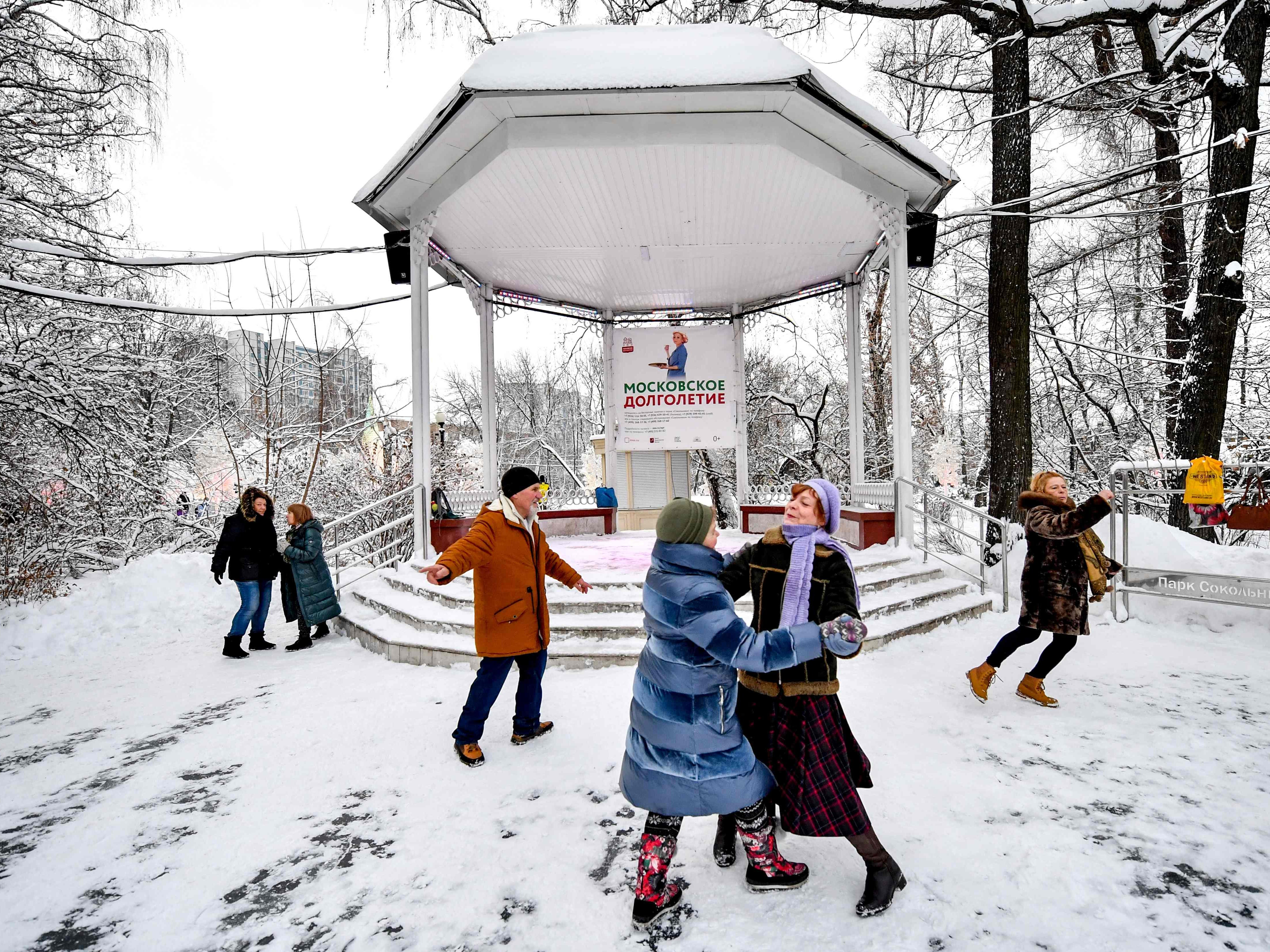 People dance on the snow at the Sokolniki park in Moscow, Jan.  4, 2019.