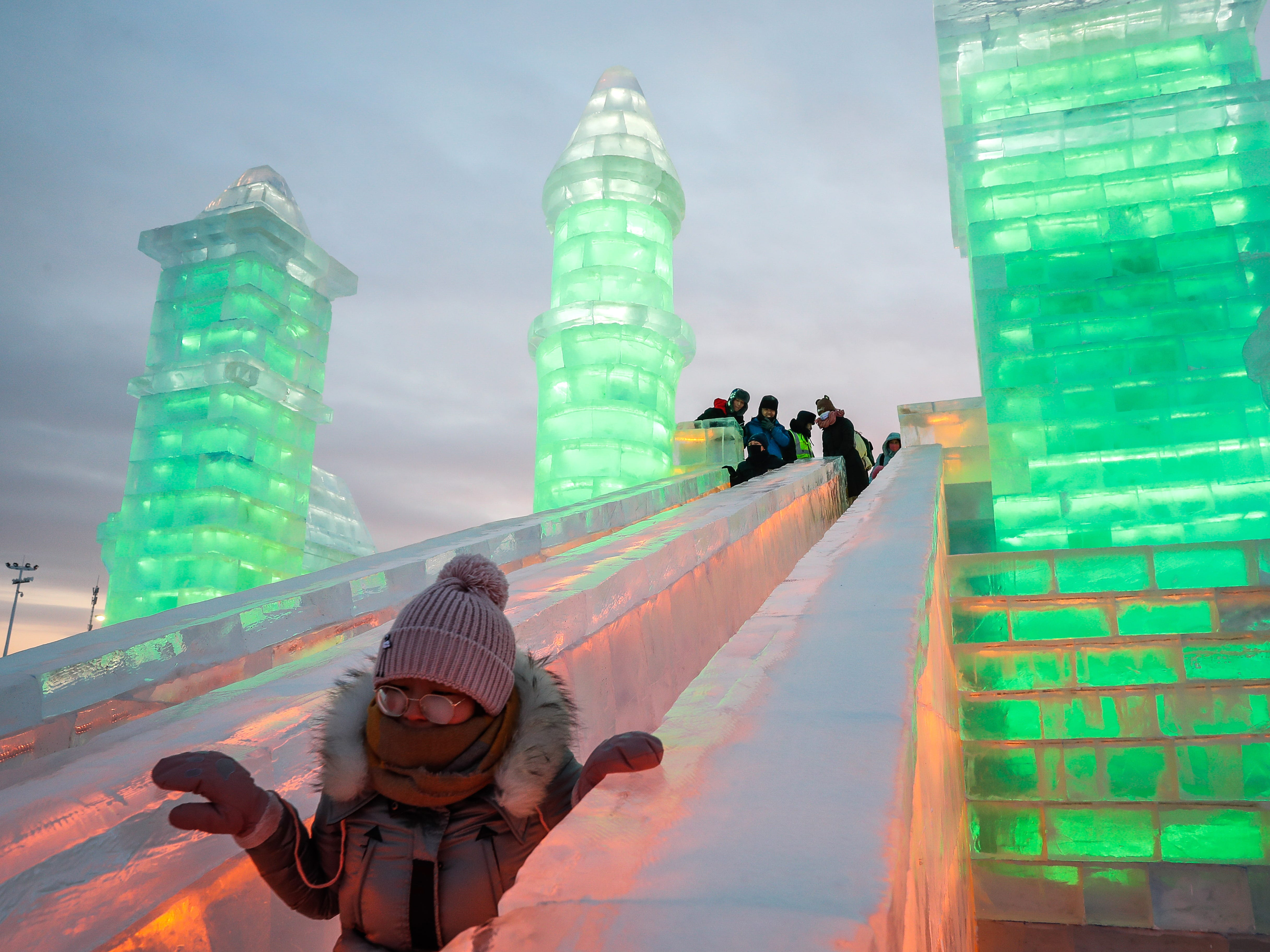 A child rides a slide at the Ice and Snow World during the annual Harbin International Ice and Snow Sculpture Festival.