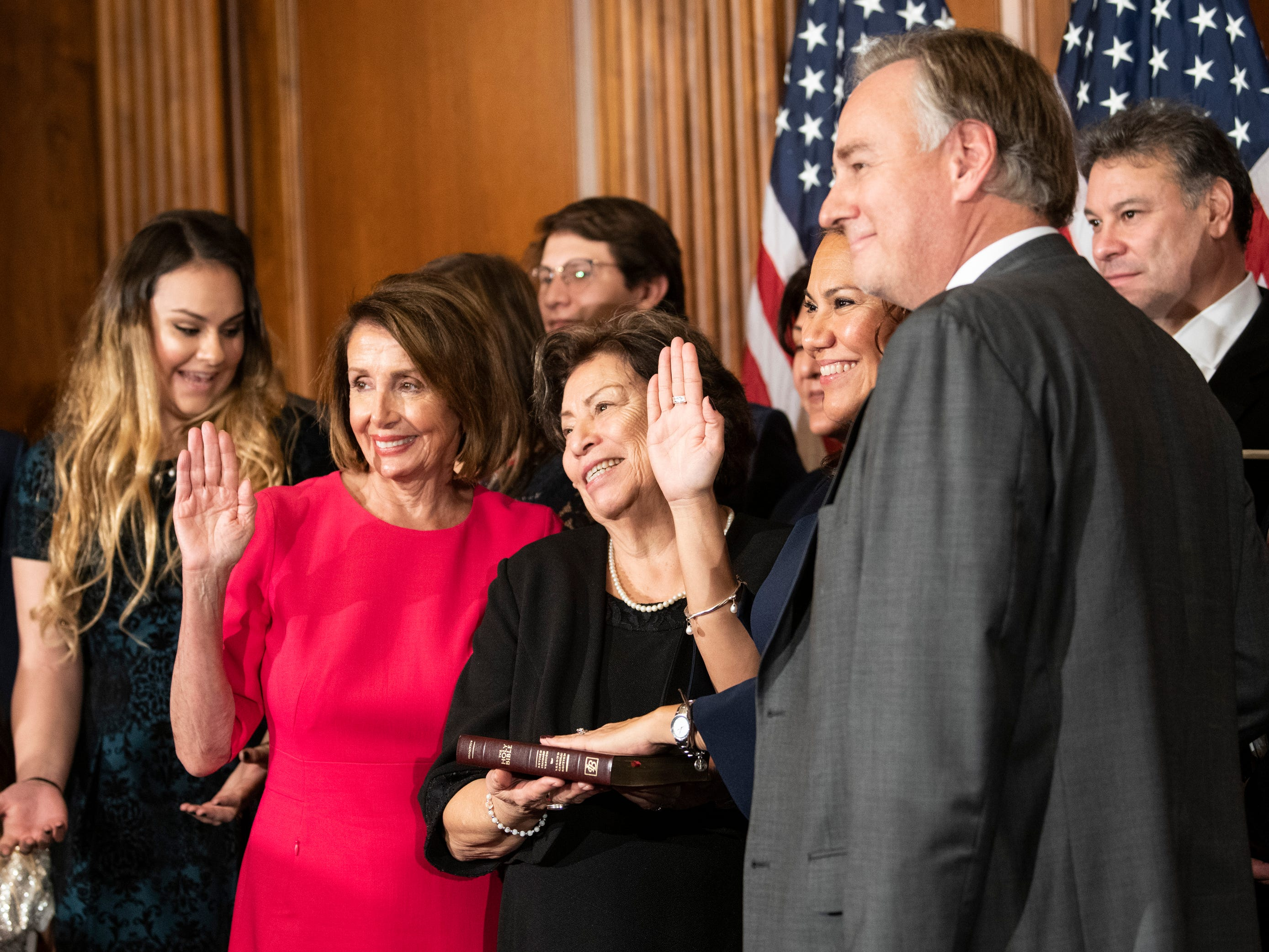 Rep. Veronica Escobar (D, TX) is surrounded by family while being sworn in by House Speaker Nancy Pelosi, on Jan. 3, 2019 in Washington D.C.