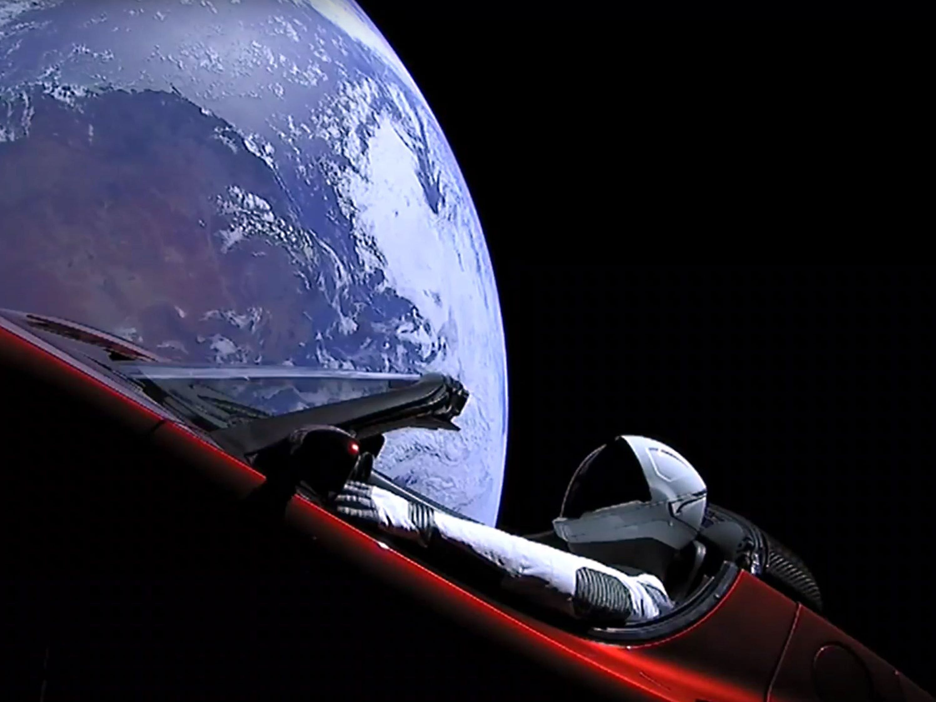 """""""Starman"""" sitting in SpaceX CEO Elon Musk's cherry red Tesla roadster after a Falcon Heavy rocket delivered it into orbit around the Earth on Feb. 6, 2018."""