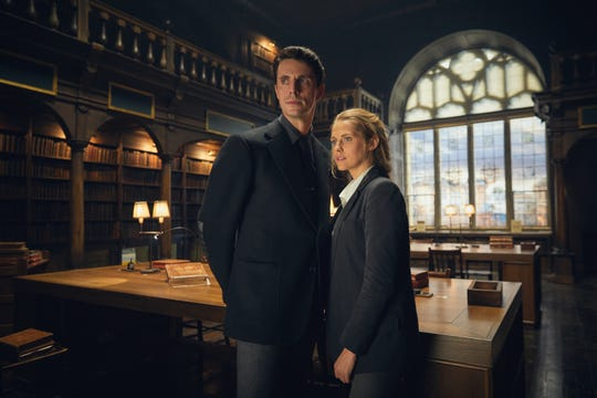 "Matthew Goode as Matthew Clairmont and Teresa Palmer as Diana Bishop in ""A Discovery of Witches."""