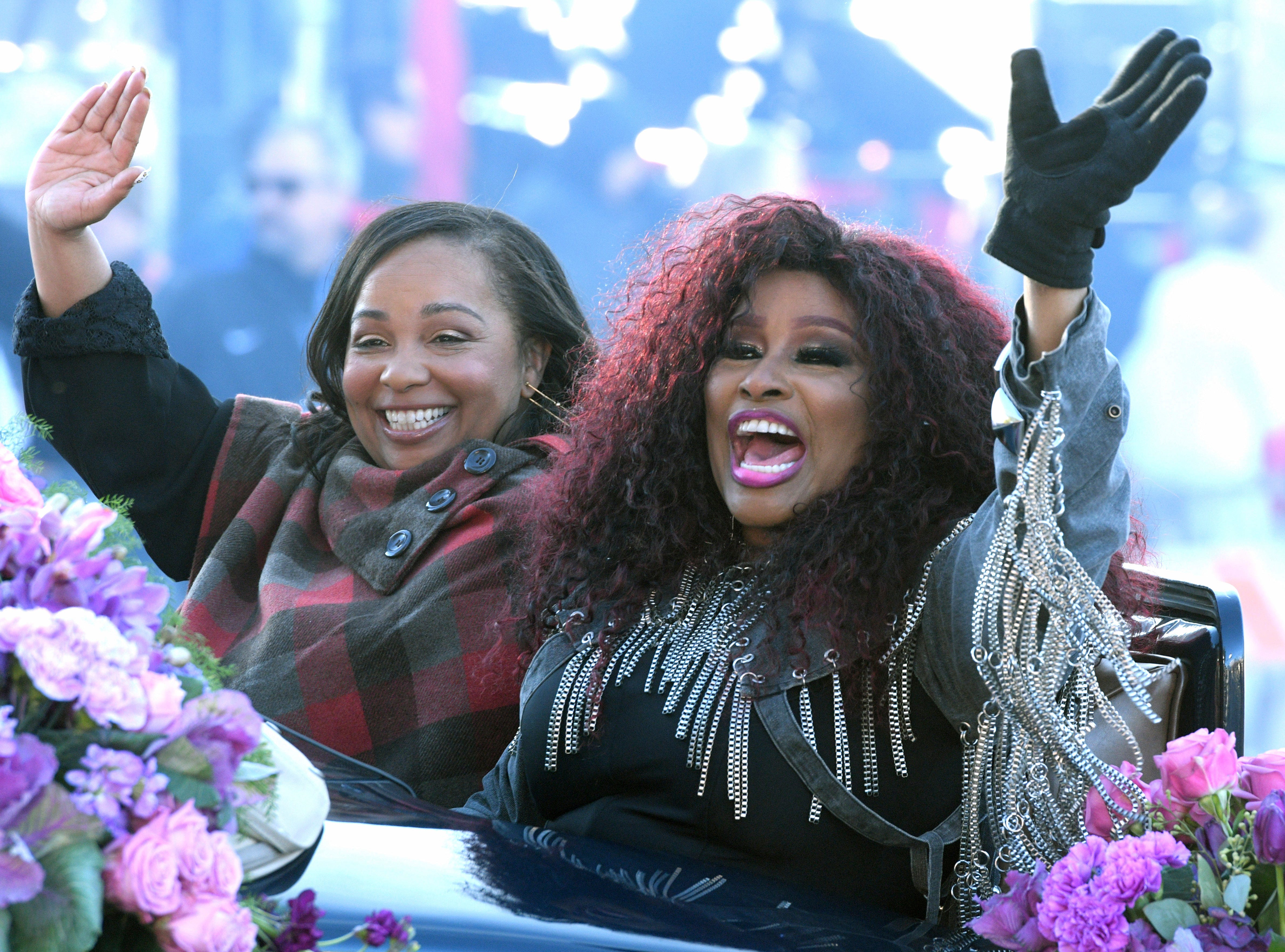 Tournament of Roses Grand Marshal Chaka Khan, right, and her daughter Indira Milini Khan wave to the crowd at the 130th Rose Parade in Pasadena, Calif., Tuesday, Jan. 1, 2019. (AP Photo/Michael Owen Baker) ORG XMIT: CAMB225