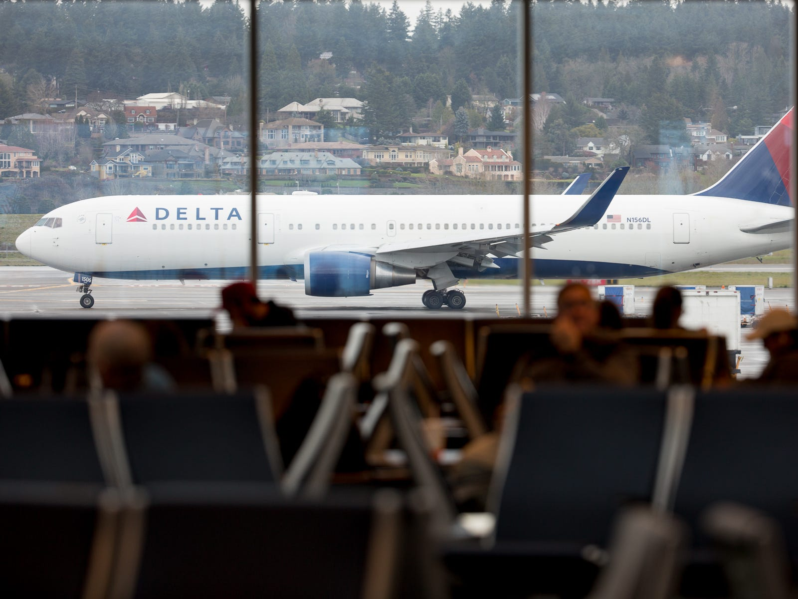 A Delta Air Lines Boeing 767-300 taxis out for departure to Tokyo from Portland International Airport in December 2018.