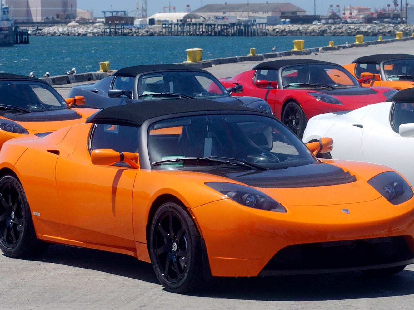 Some of twelve Tesla Roadsters bound for Japan are seen at a dock in Port Hueneme, Calif. April 21, 2010.