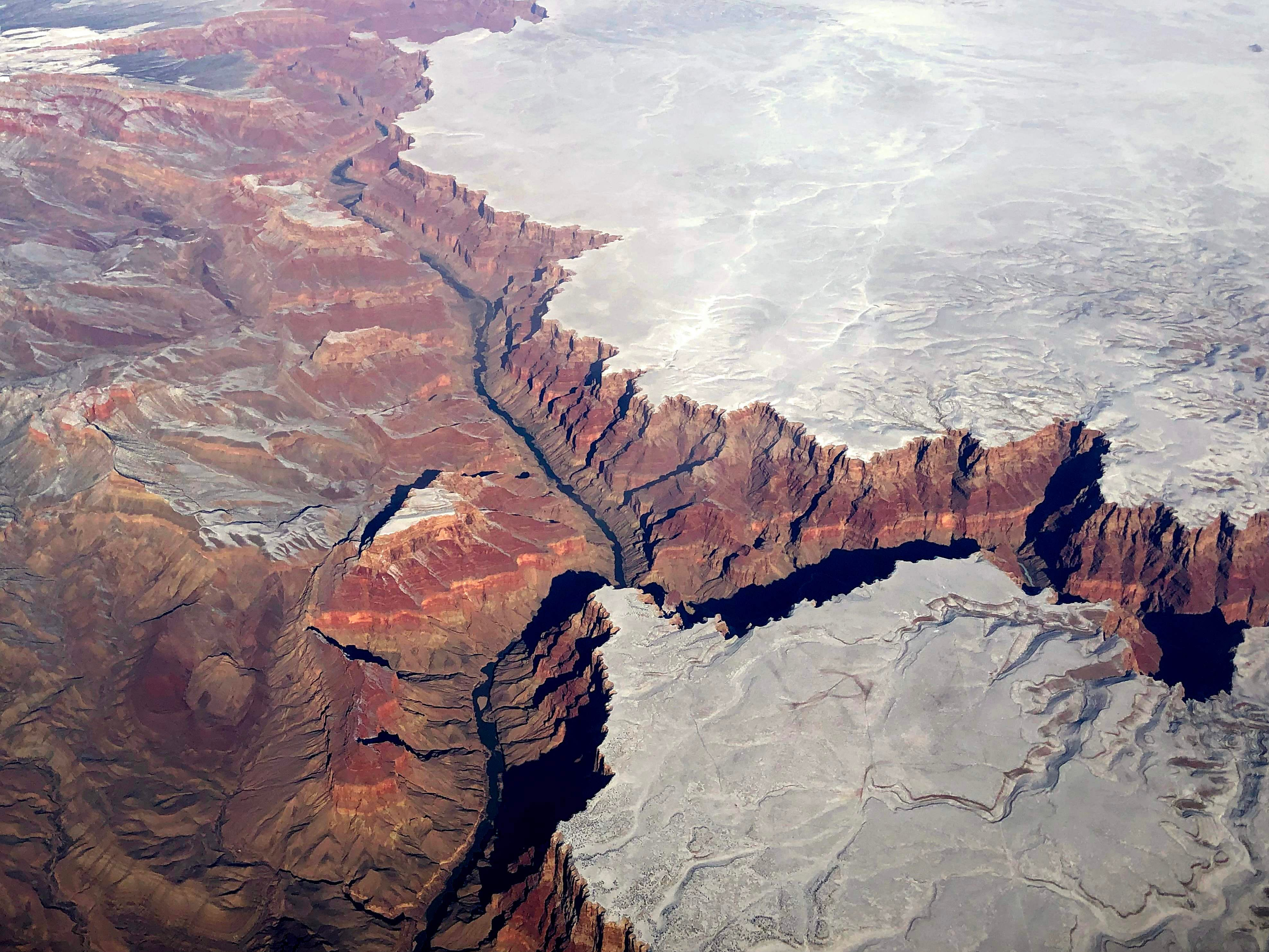 An aerial picture taken on Jan. 3, 2019, shows the Grand Canyon covered with snow in AZ.