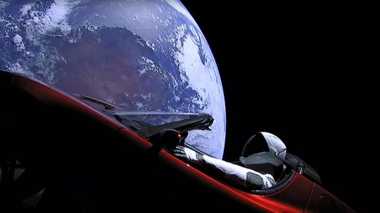 """Starman"" sitting in SpaceX CEO Elon Musk's cherry red Tesla roadster after a Falcon Heavy rocket delivered it into orbit around the Earth on Feb. 6, 2018."
