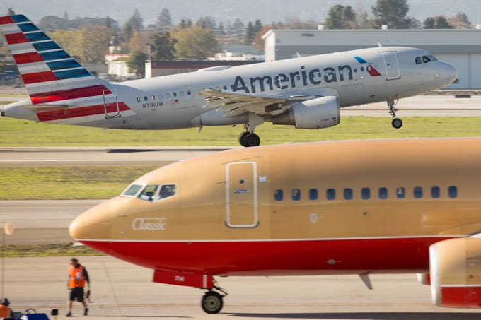 An American Airlines Airbus A319 takes off from San Jose International Airport while a Southwest Airlines Boeing 737-700 is set to depart in December 2018.