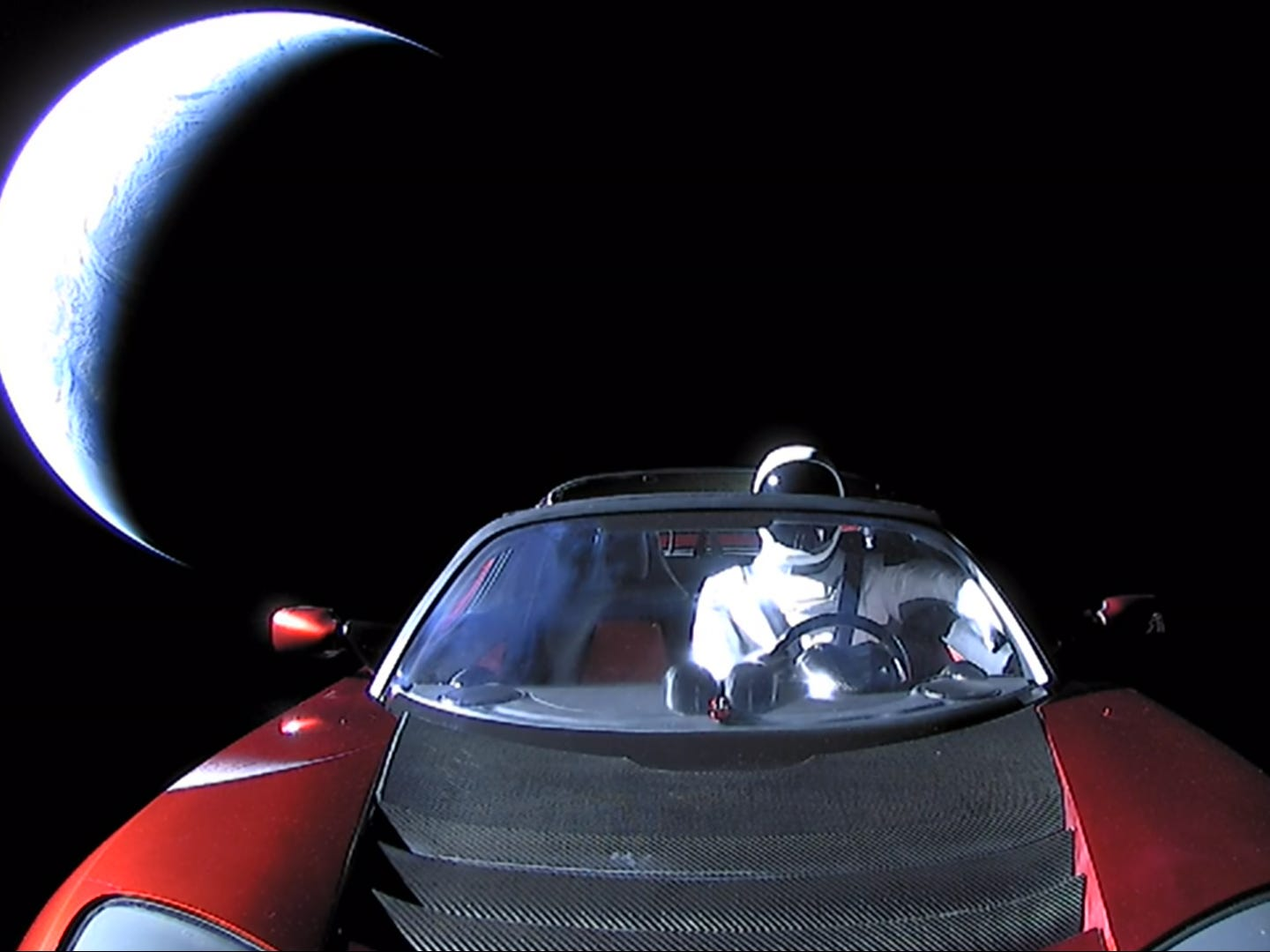 "A Tesla Roadster and ""Starman"" mannequin head toward deep space after launching on Falcon Heavy on Feb. 6, 2018."