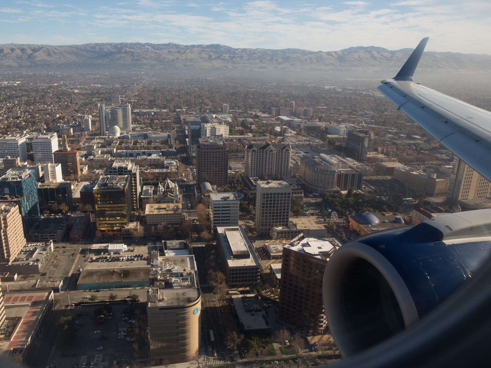Downtown San Jose, California, fills the window on an early morning flight to San Jose International Airport in December 2018.