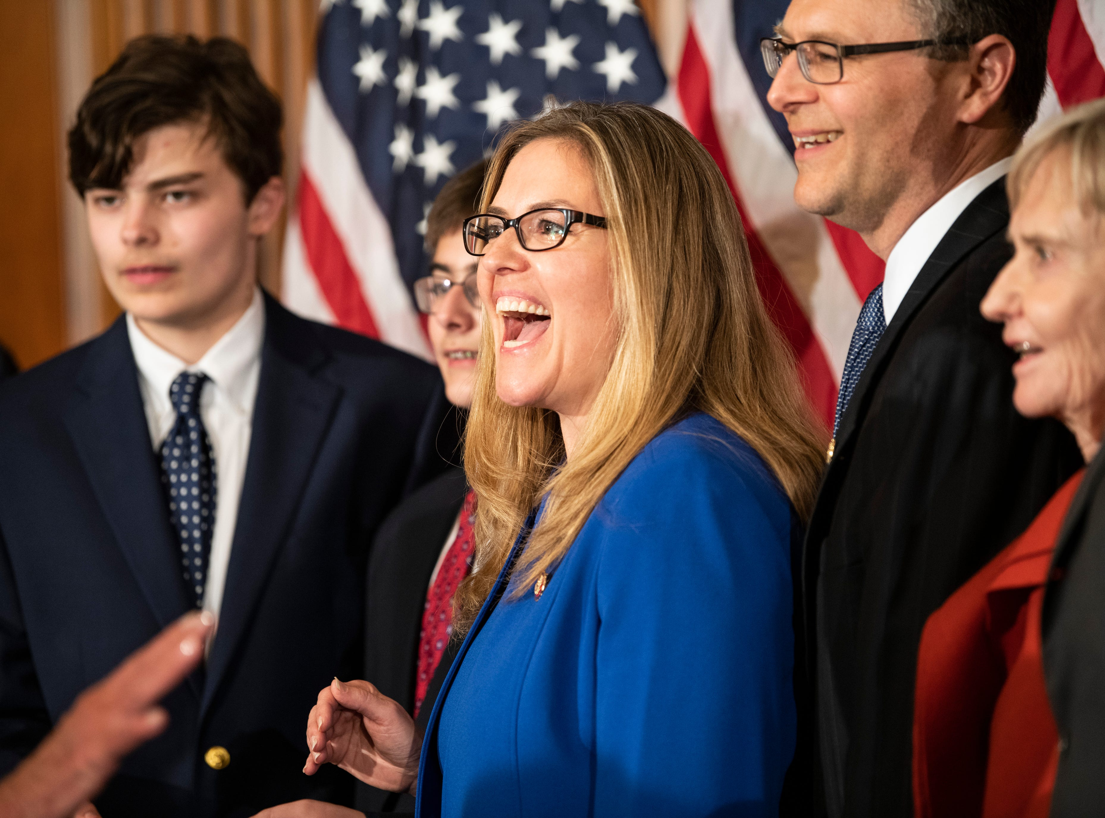 Rep. Jennifer Wexton (D, VA) enjoys a laugh while waiting to be sworn in by House Speaker Nancy Pelosi as a member of the 116th Congress.