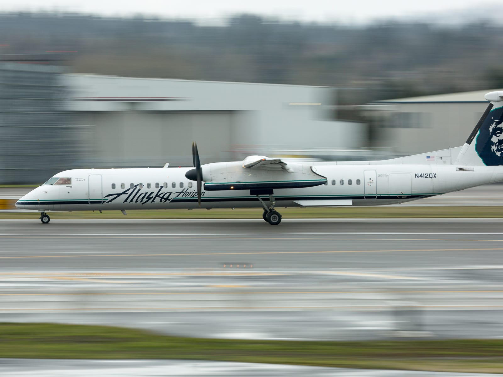 An Alaska Airlines Bombardier Q400 takes off from Portland International Airport in December 2018.