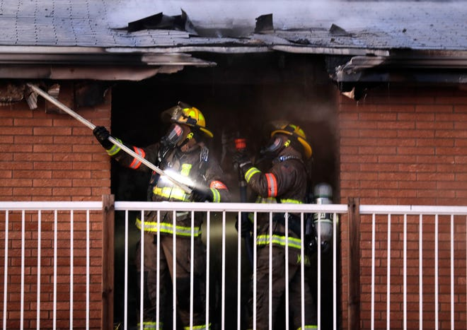Kimberly firefighters work to extinguish a fire in an apartment building at 1516 W. Fourth St.