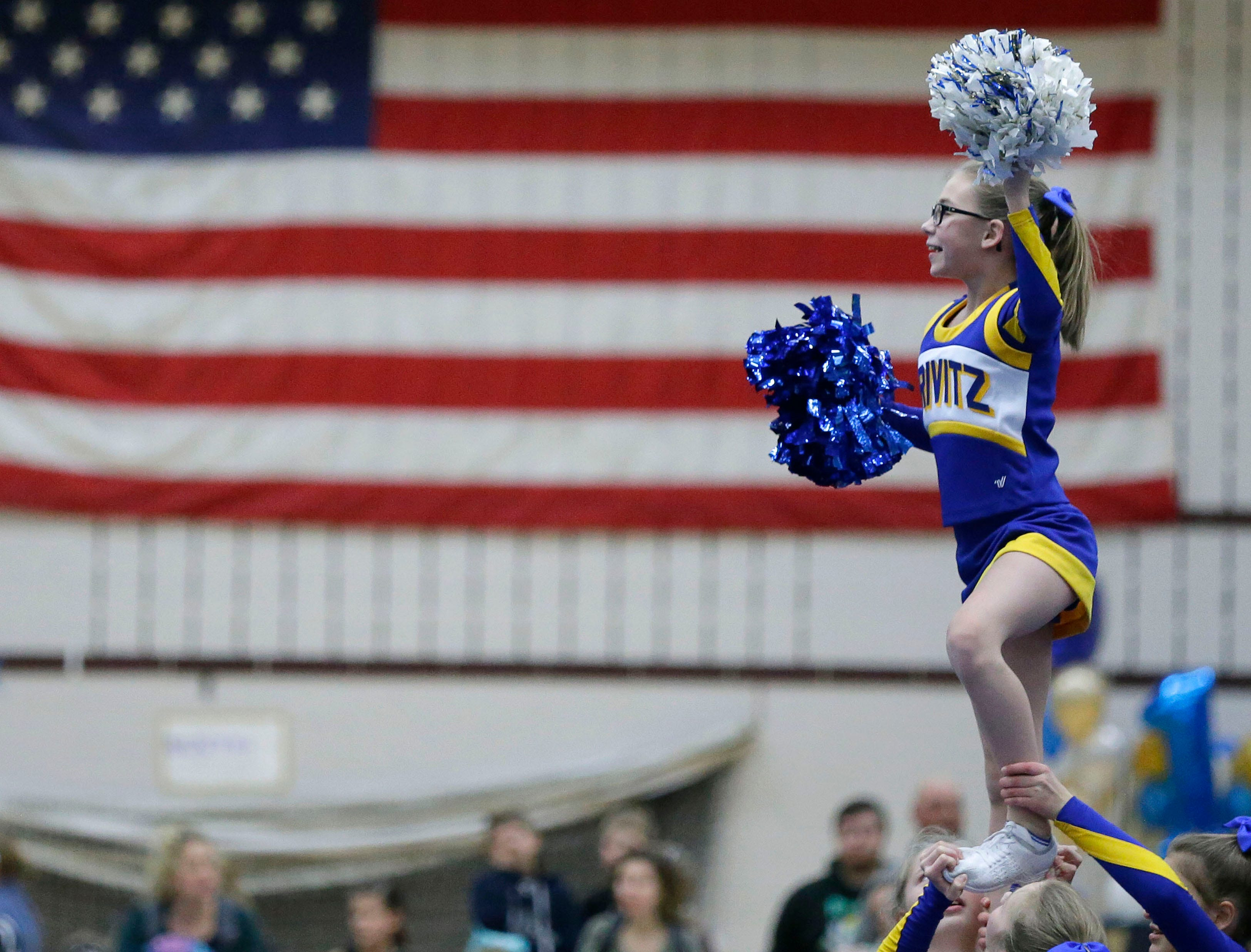 A Crivitiz team performs as the Lightning Bolt Explosion Cheer and Dance competition takes place Saturday, January 5, 2019, at Appleton North High School in Appleton, Wis.