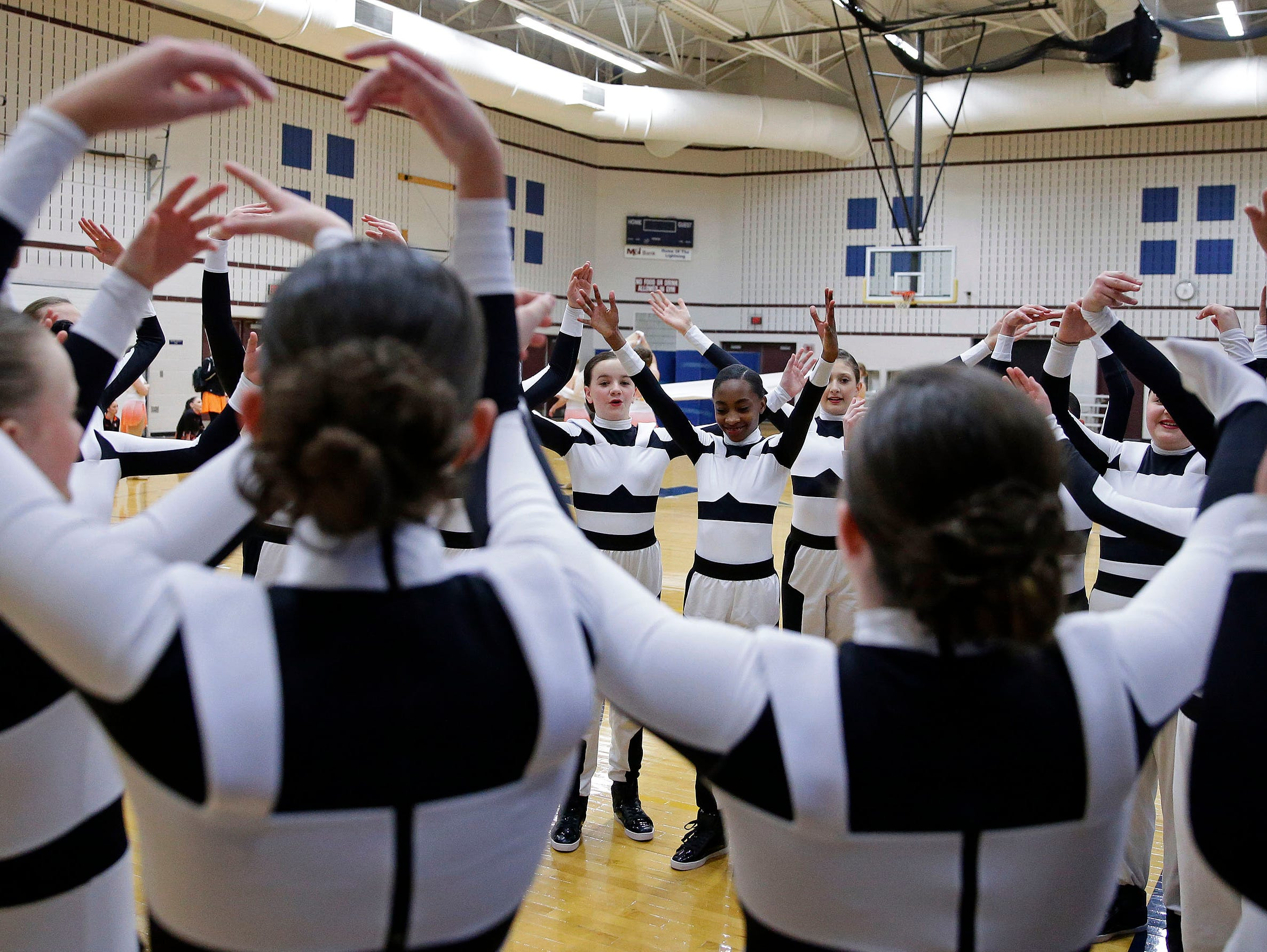 A team gets ready to compete as the Lightning Bolt Explosion Cheer and Dance competition takes place Saturday, January 5, 2019, at Appleton North High School in Appleton, Wis.