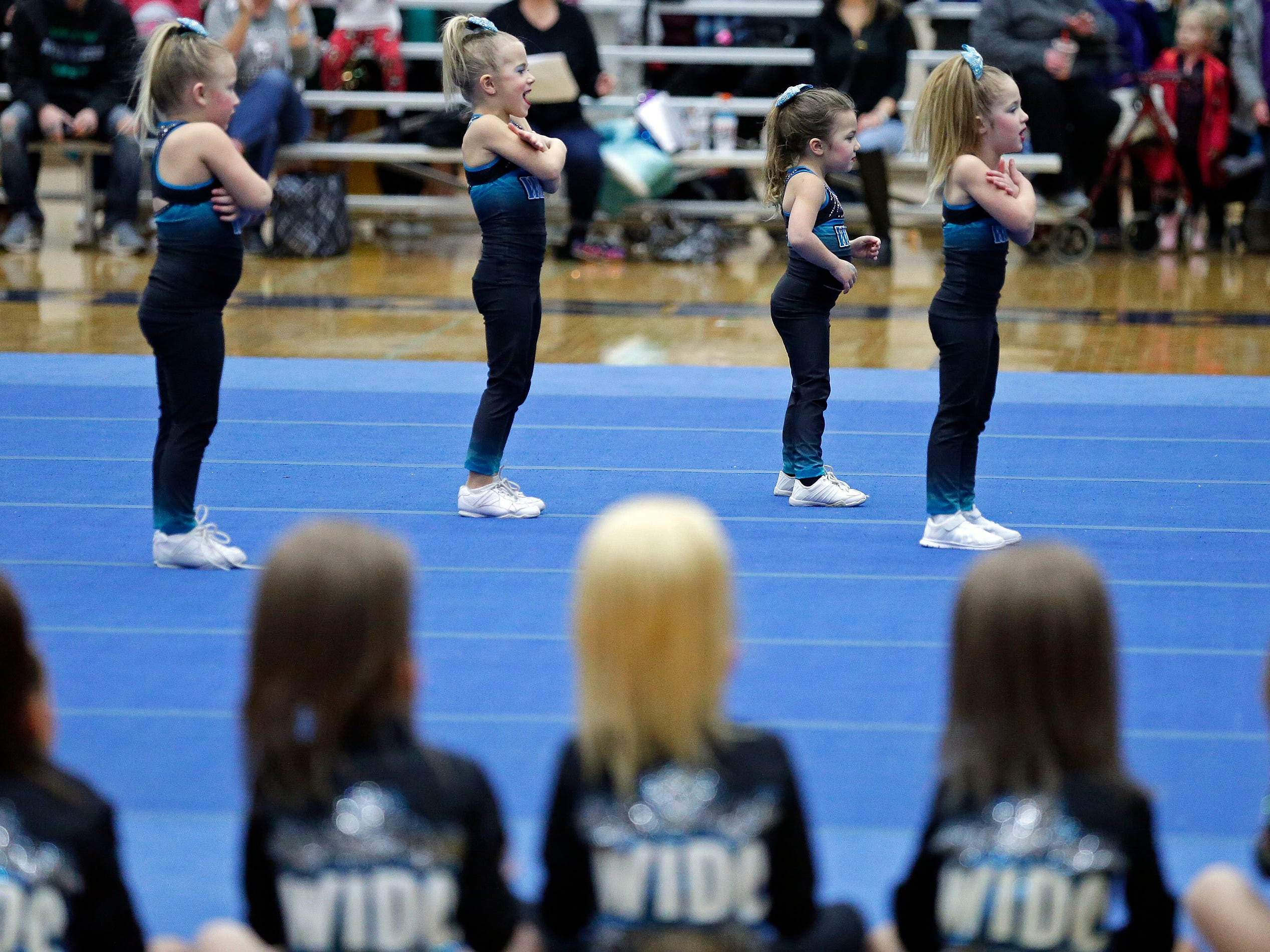 A WIDC teams competes while other WIDC members cheer them on as the Lightning Bolt Explosion Cheer and Dance competition takes place Saturday, January 5, 2019, at Appleton North High School in Appleton, Wis.