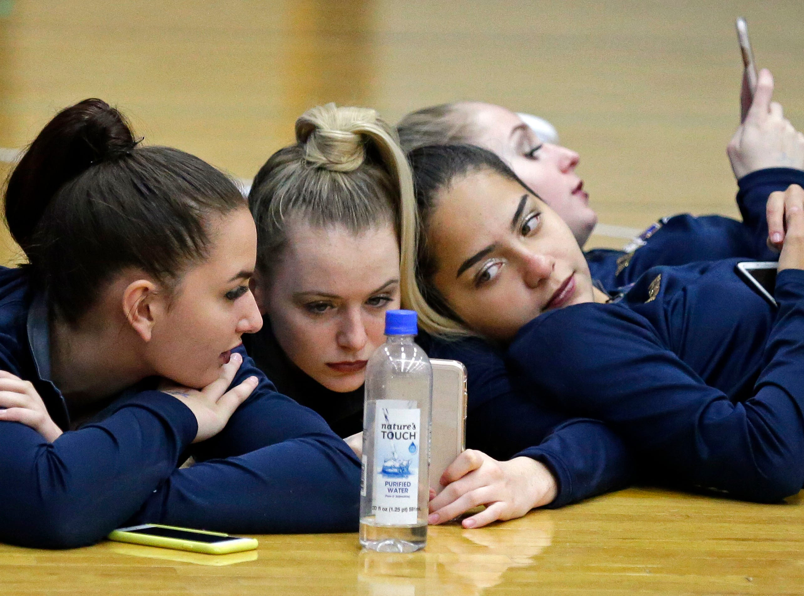 Emily Bauer, left, Grace Hurrie, center, and Miranda Garcia of Sheboygan North have time to relax as the Lightning Bolt Explosion Cheer and Dance competition takes place Saturday, January 5, 2019, at Appleton North High School in Appleton, Wis.