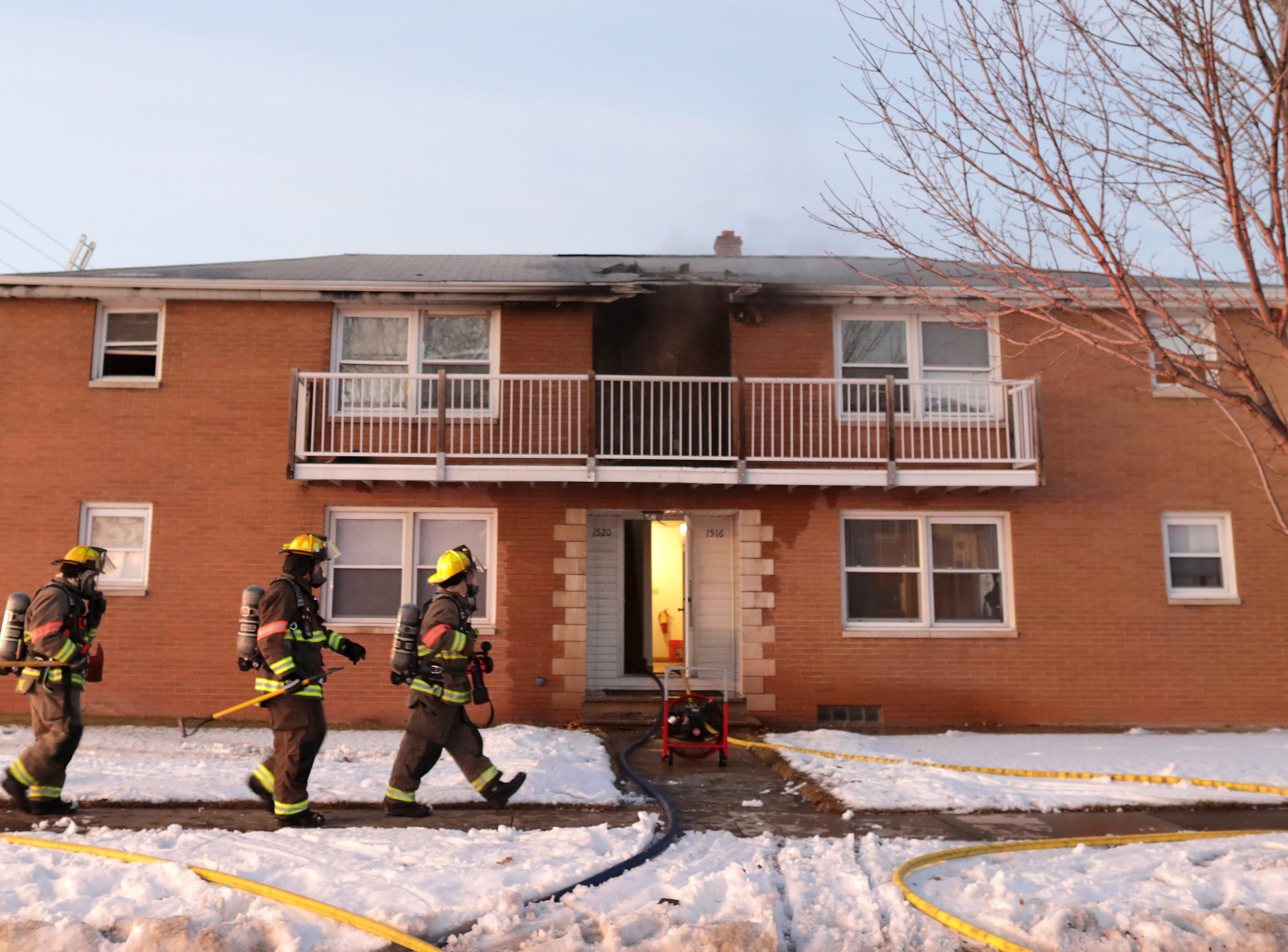Firefighters from the Kimberly Fire Department on the scene of a second story fire in an apartment building on the1500 block of W. Fourth St. on Saturday, January 5, 2019, in Kimberly, Wis.