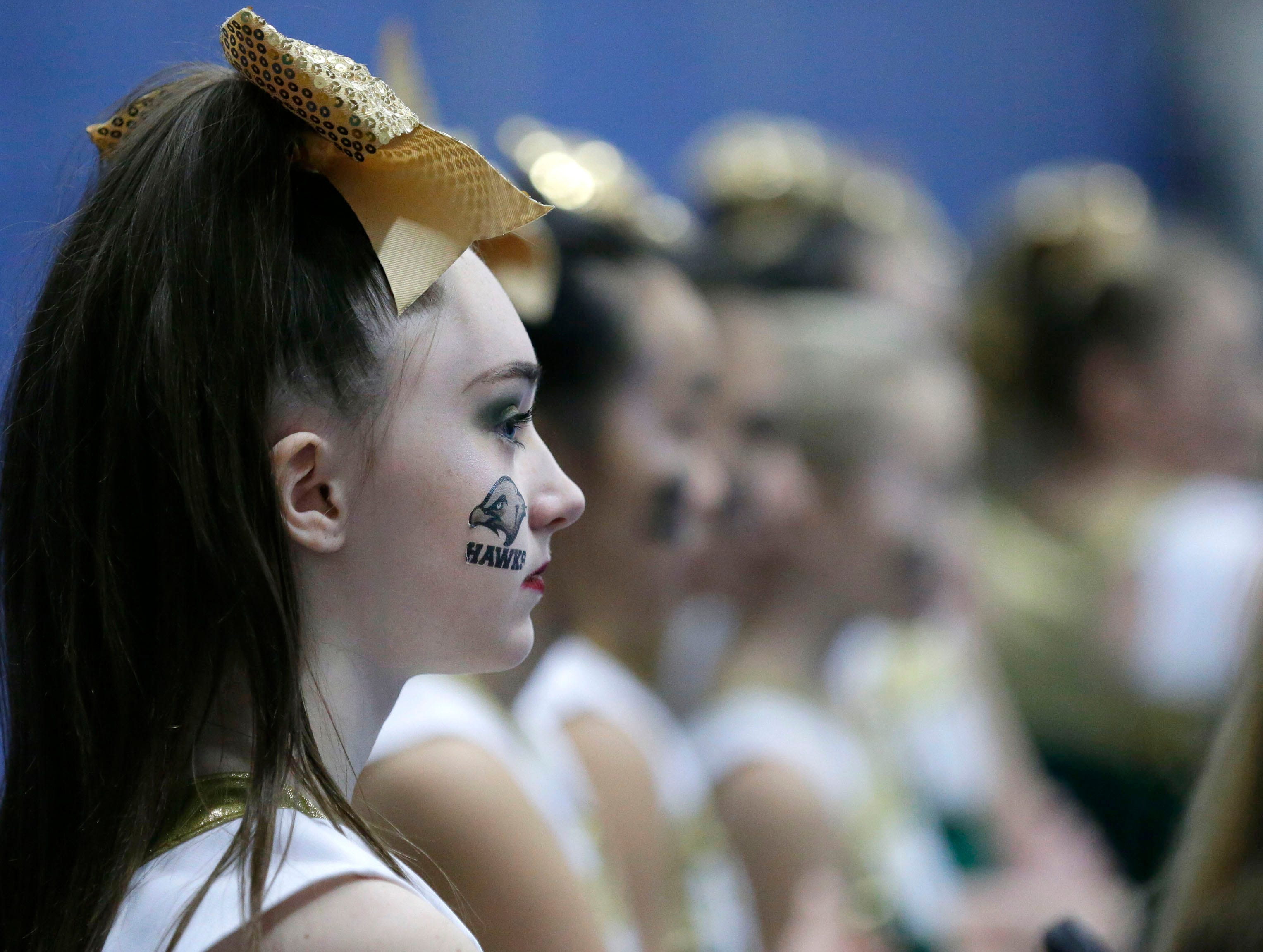 Greenfield gets ready to compete in the Middle School Division as the Lightning Bolt Explosion Cheer and Dance competition takes place Saturday, January 5, 2019, at Appleton North High School in Appleton, Wis.