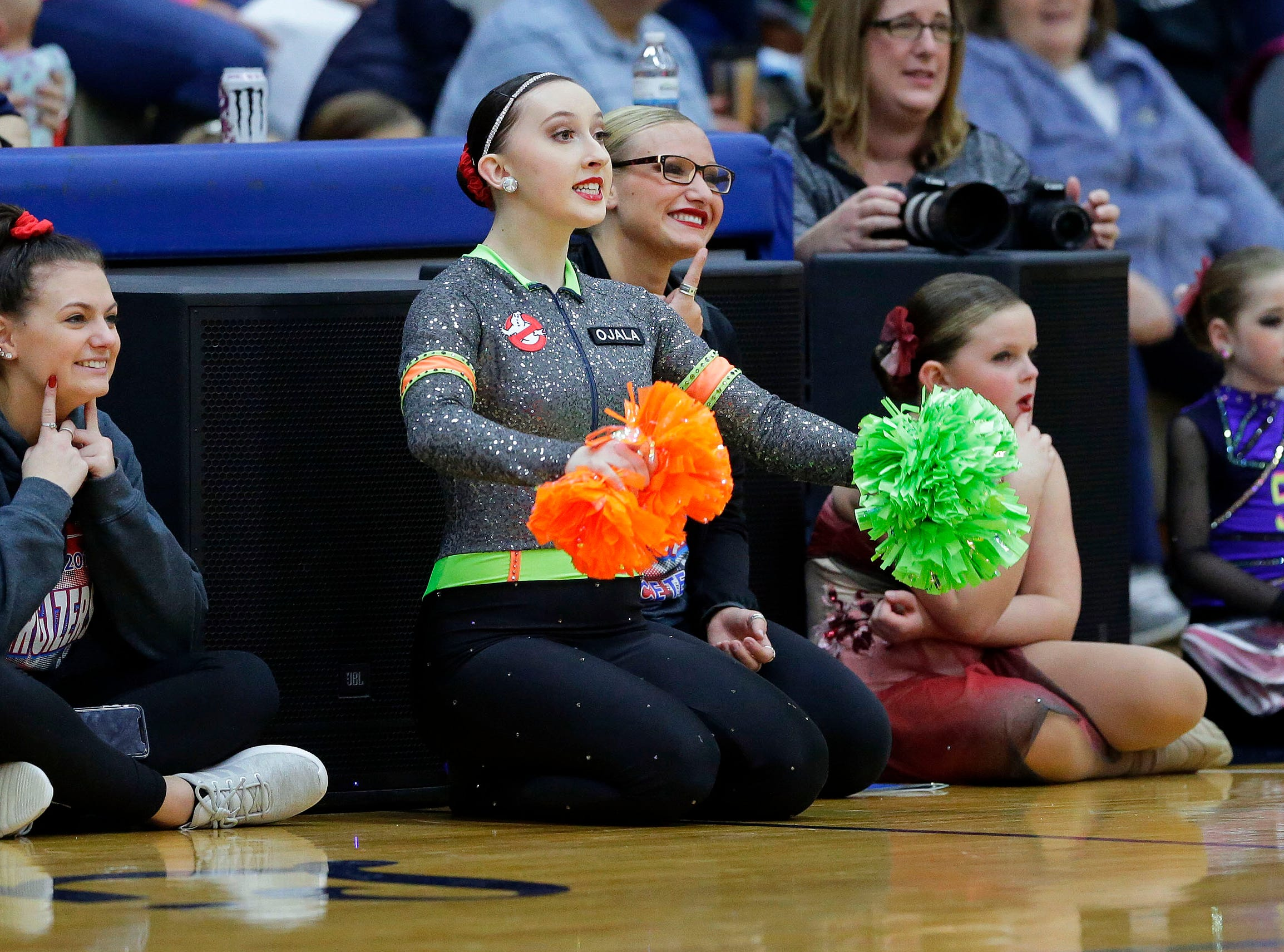 Competitors get coached by Erin Malec, left, Kaylee Ojala, center, and Alexis Trost of Hartford as the Lightning Bolt Explosion Cheer and Dance competition takes place Saturday, January 5, 2019, at Appleton North High School in Appleton, Wis.